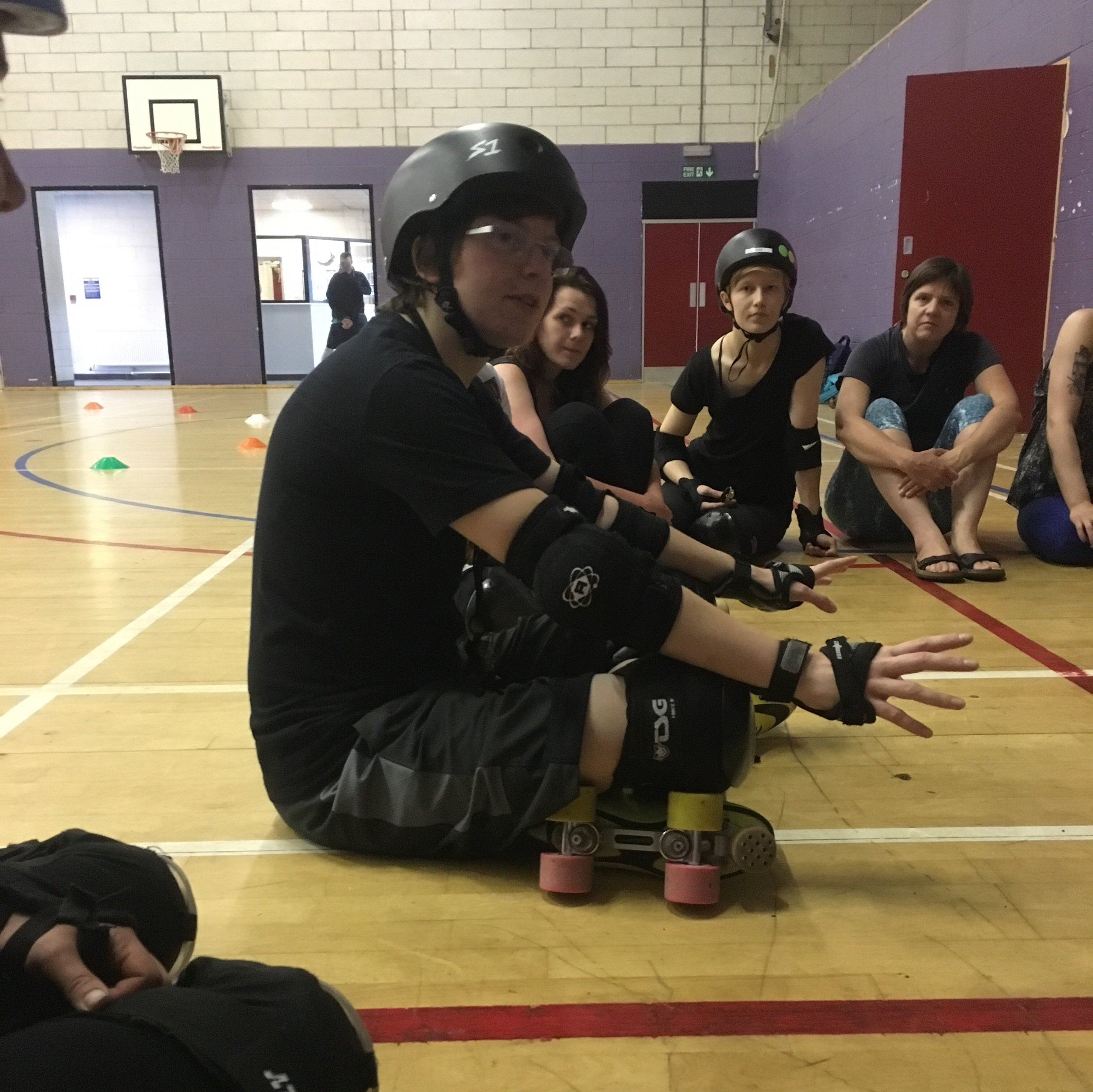 Our rookie skaters learning more about actual gameplay from self-confessed roller derby geek, Feminist Killjoy.
