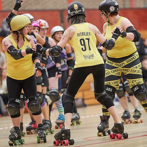 Mad Natter, NitroJen & Sadie O'Hades waiting for the offense; photo courtesy of  Roller Derby on Film .
