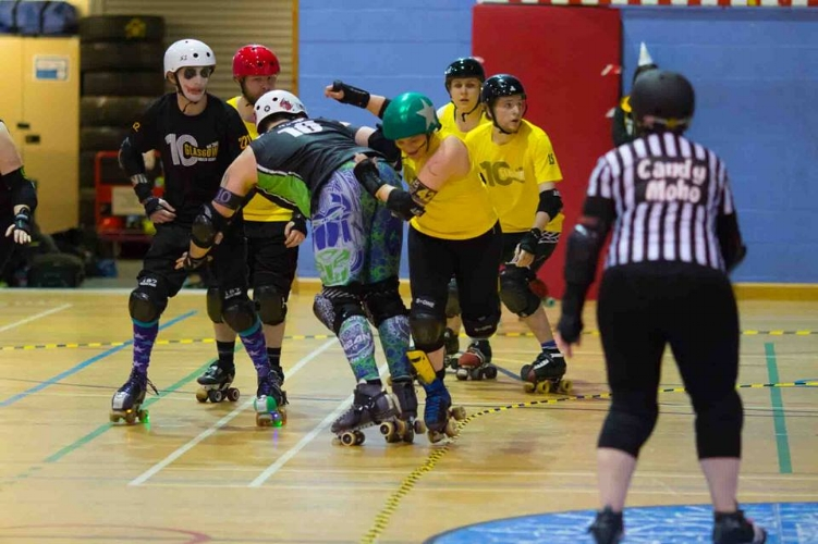 Marshall Lawless sneaks past Optimus Grime in the Co-Ed game. Photo courtesy of Ali Maddock.