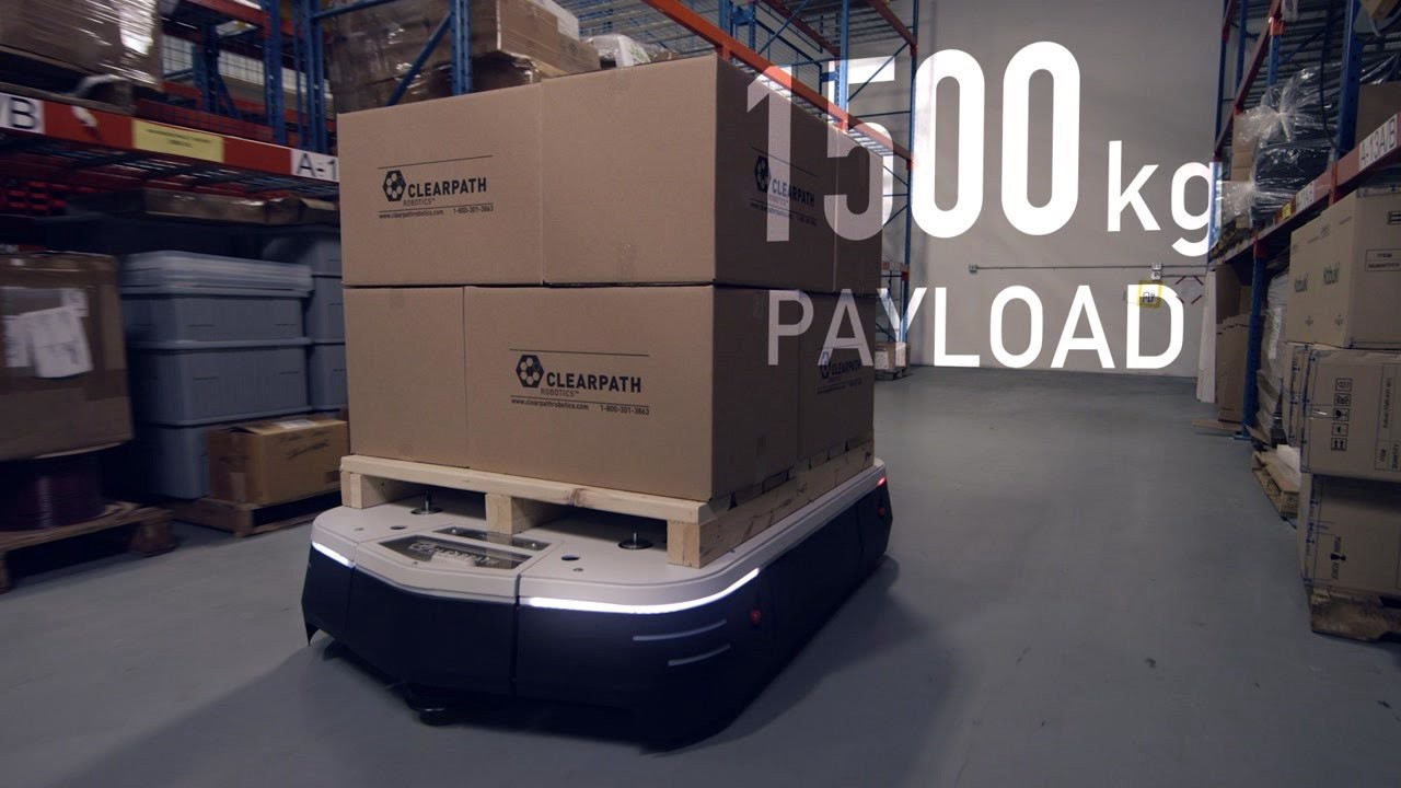 An OTTO 1500 robot autonomously navigates around a warehouse.