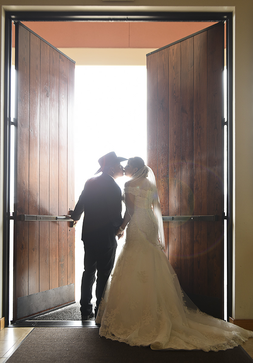 Sugar Land Wedding door kiss