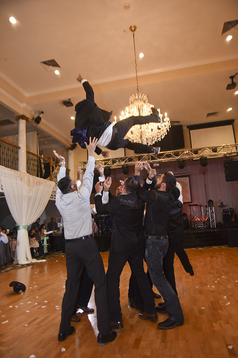 Sugar Land Wedding groom in the air