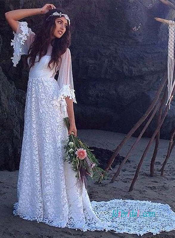 H0936-Vintage-flowy-airy-lace-bohemian-beach-wedding-dress-with-bell-long-sleeves.jpg