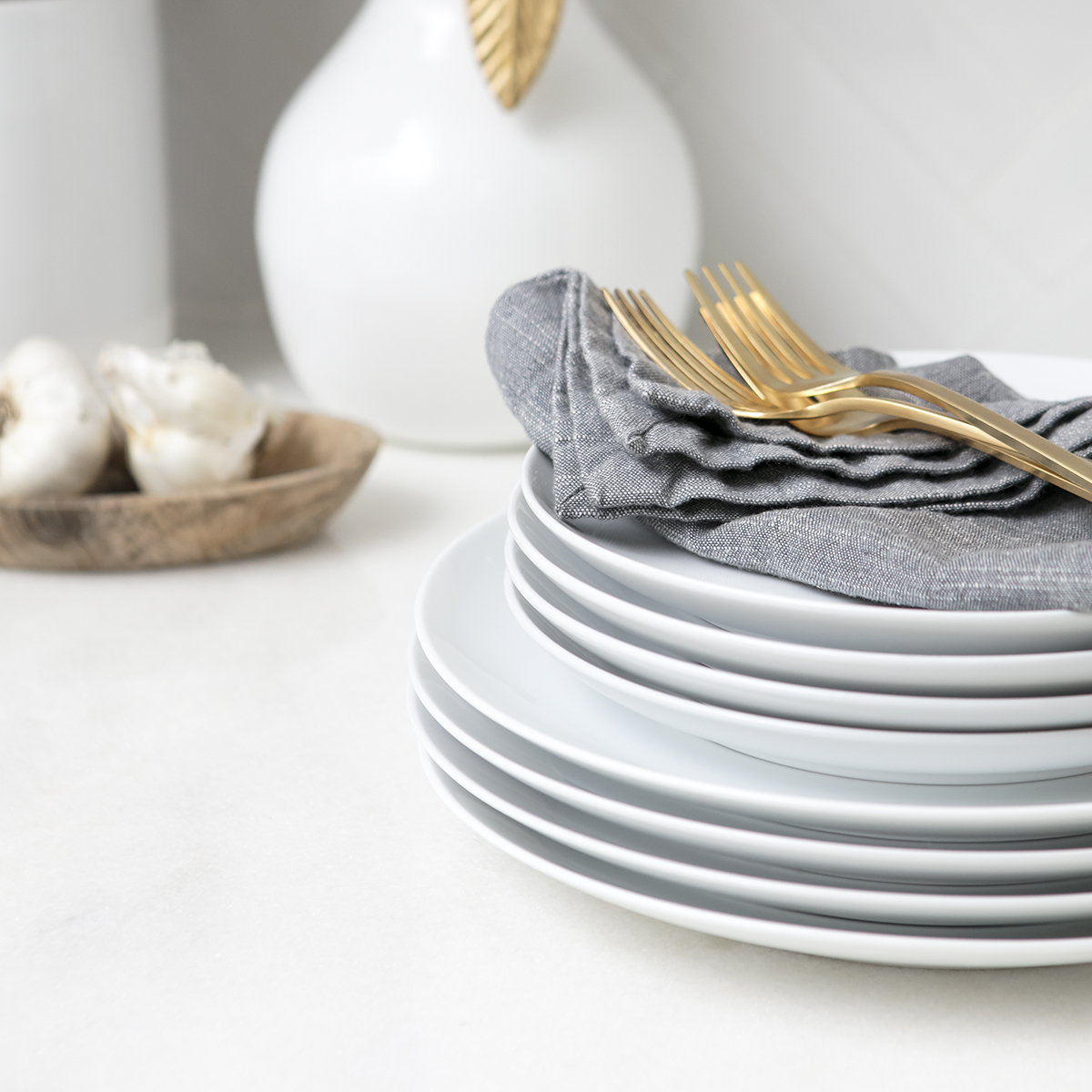 Clean stack of white dishes.JPG