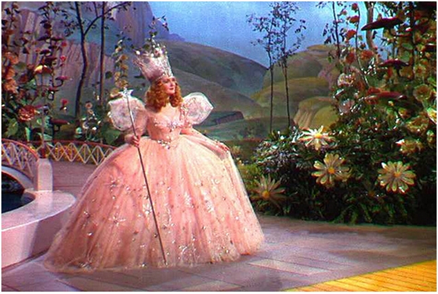 The Wizard of Oz ~ Glinda the Good Witch! Look at the flowers and the saturation of colour and the grainyness of the film!