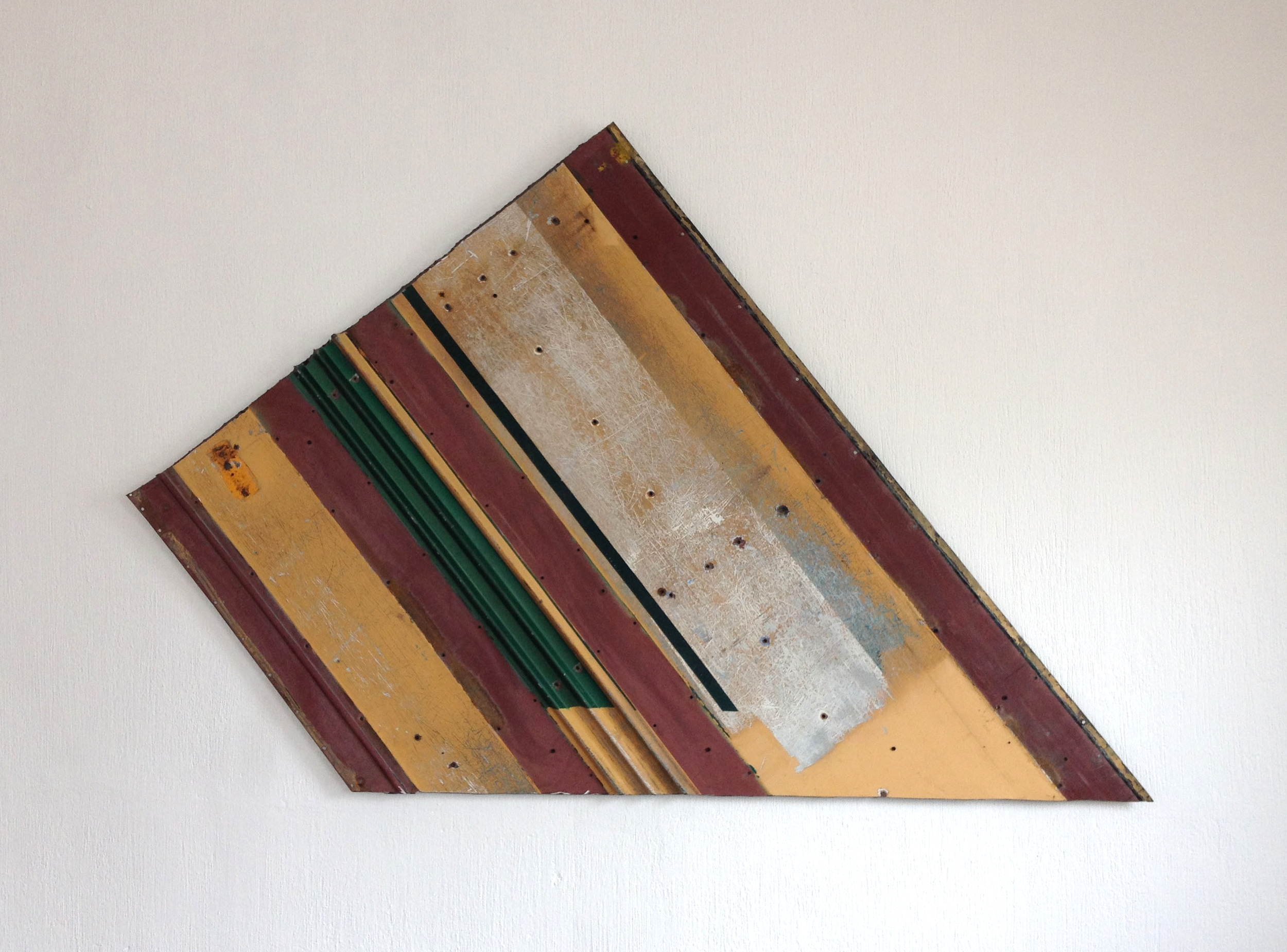 Geometric Construction No. 1    2014  Urban bus found iron panel  assambled on wood and conserved with  acryloid.  168 x 104 x 4 cm.  Photo credit: artist