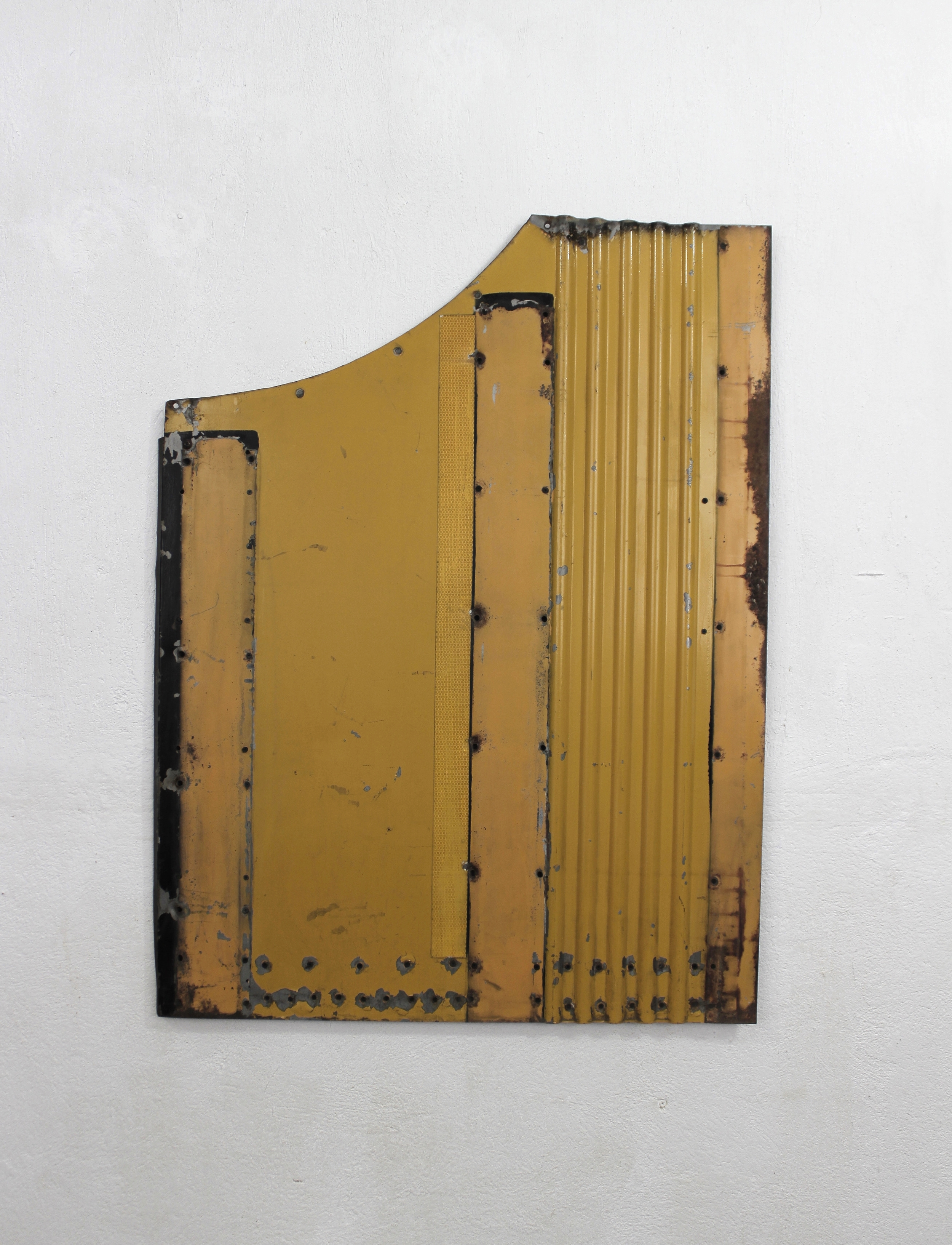 Geometric Relief No. 5   2014  Found rusted urban bus external panel, automotive paint,polyvinyl and acryloid.  115 x 87 x 3 cm  Photo credit: Diego Sagastume