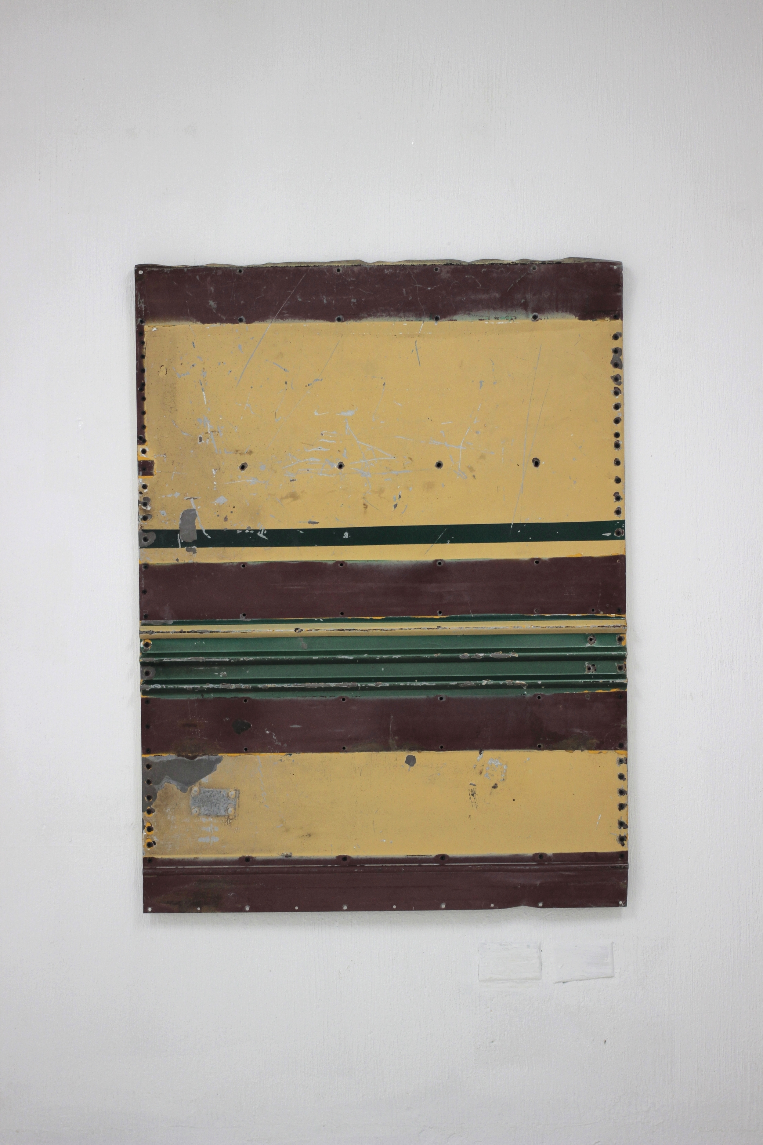 Geometric Relief No. 6   2014  Found urban bus panel assembled on wood and converved with acryloid.  118 x 88.5 x 3 cm  Photo credit: Diego Sagastume
