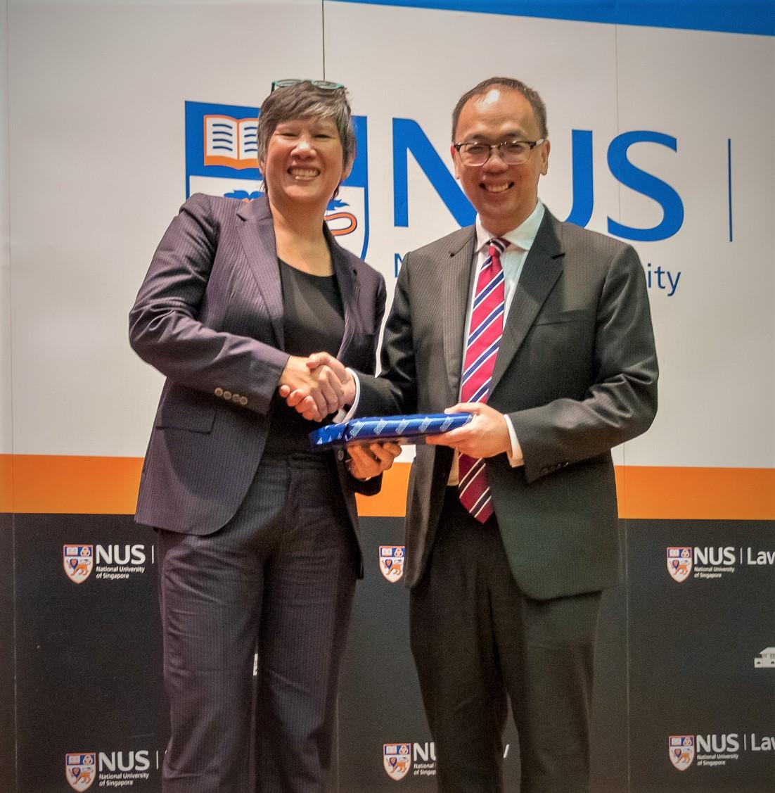 Associate Professor Eleanor Wong presenting a token of appreciation to Justice Abdullah.