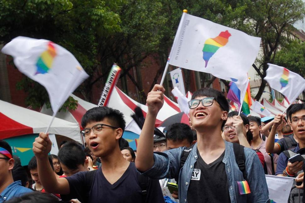 Supporters of same-sex marriage outside the Legislative Yuan in Taipei, Taiwan on the day of the Court decision. (CHIANG YING-YING/AP PHOTO)