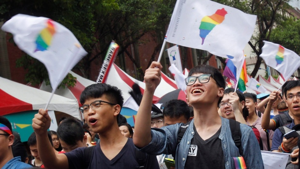 Marriage equality supporters celebrated after Taiwan's Constitutional Court ruled in favor of same-sex marriage. (Chiang Ying-ying/Associate Press)