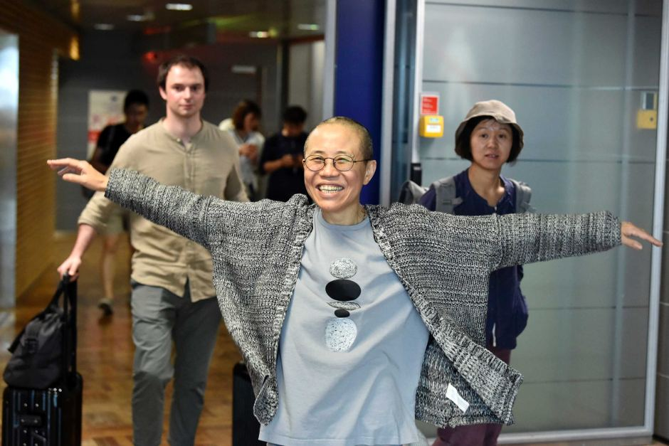 Liu Xia arrives at the Helsinki International Airport in Finland on July 10 (Jussi Nukari/AP)
