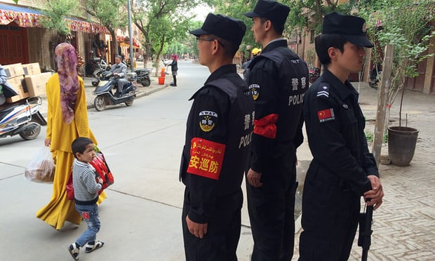 Police patrolling the old town in Kashgar, Xinjiang. Photograph: Tom Phillips for the Guardian