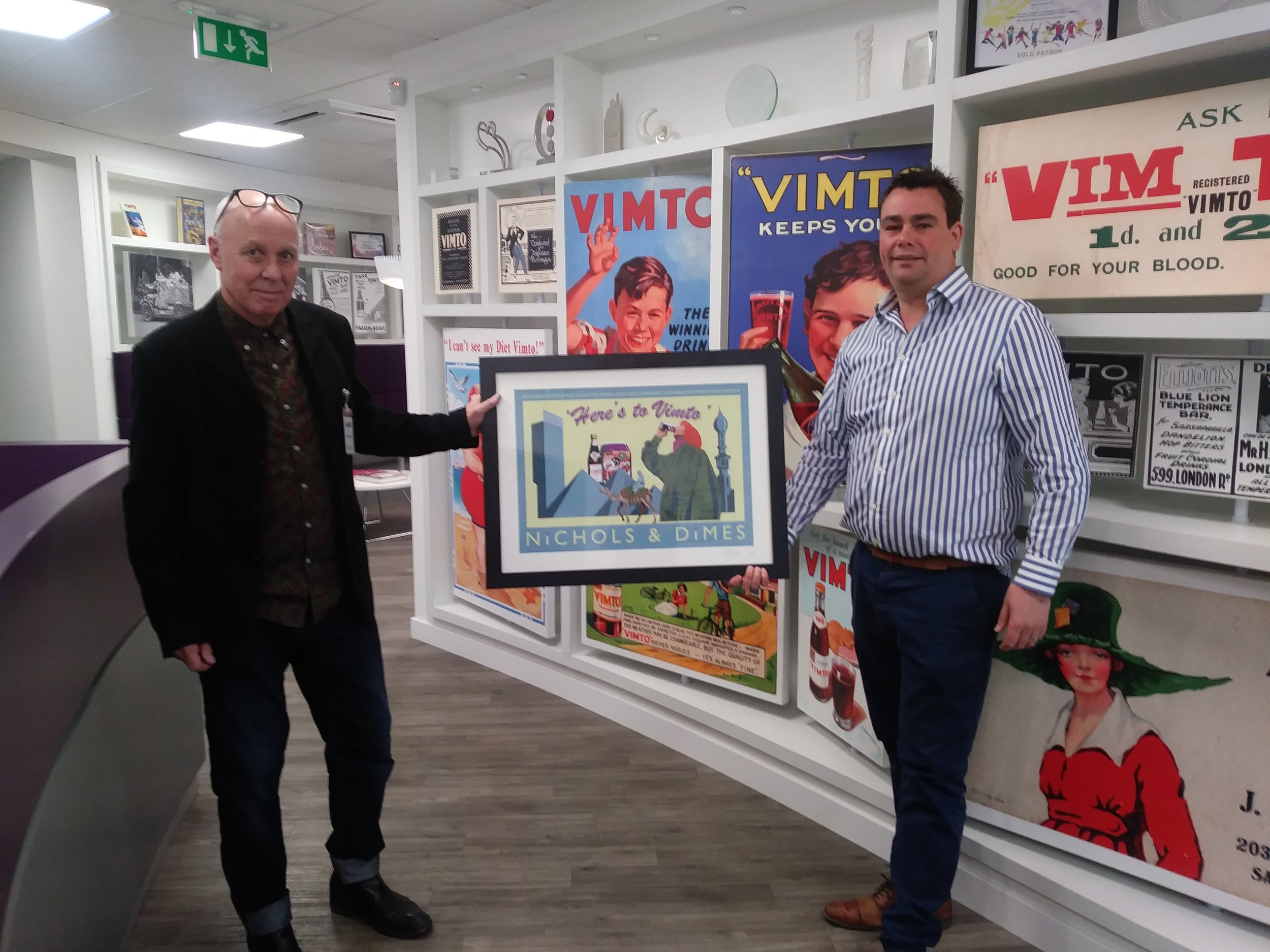 Handing over the Vimto poster to James Nichols