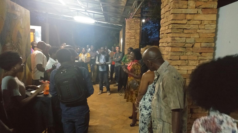 Festival Director Asiimwe Deborah Kawe addresses the crowd at the opening reception
