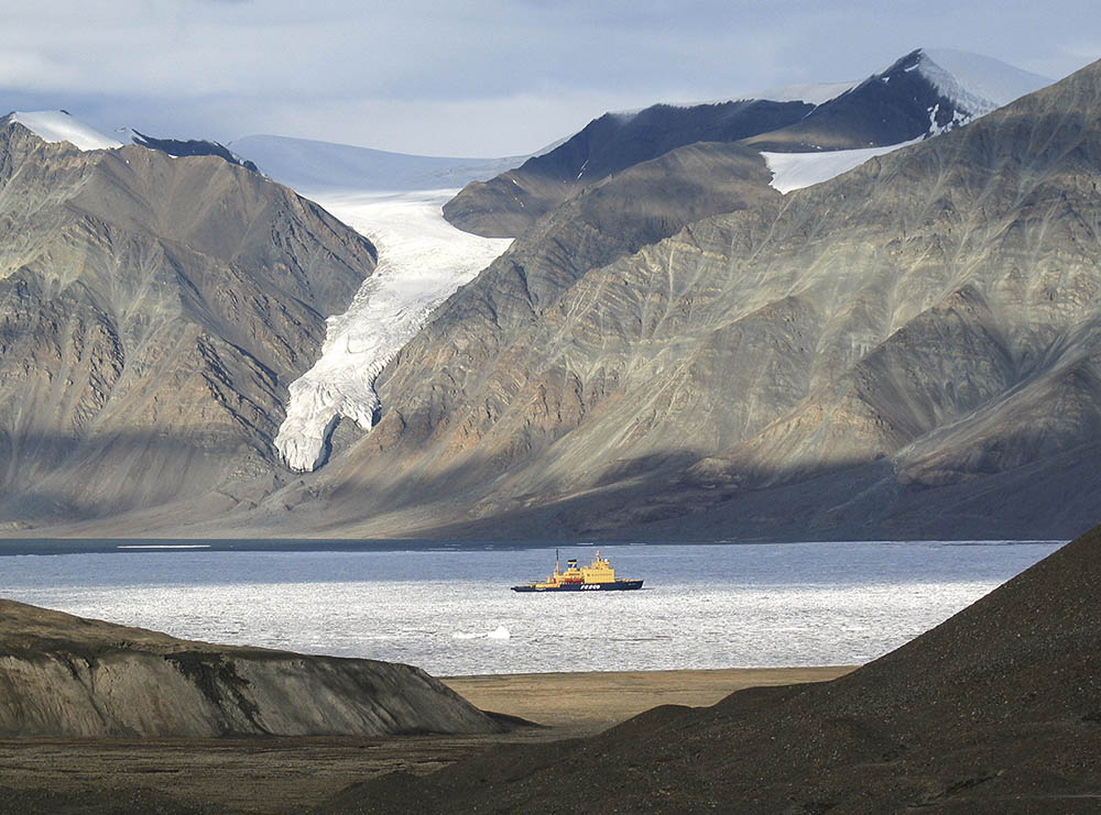 The icebreaker looks like a toy in the cast landscape of Tanquary Fiord, Ellesmere island.