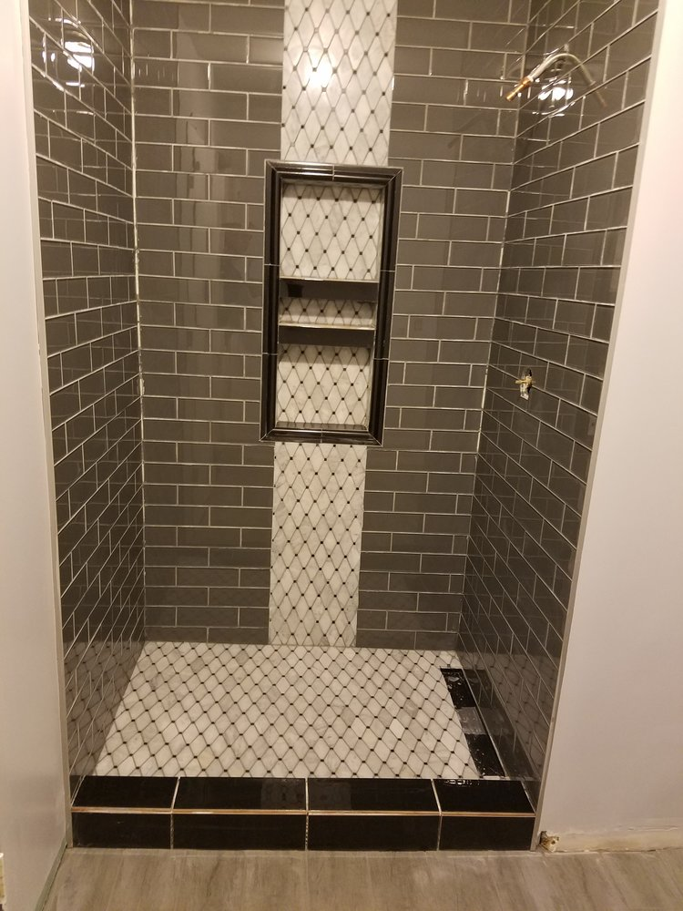 Remodel - bathroom with new vanity, lighting and custom shower with nitches.jpg