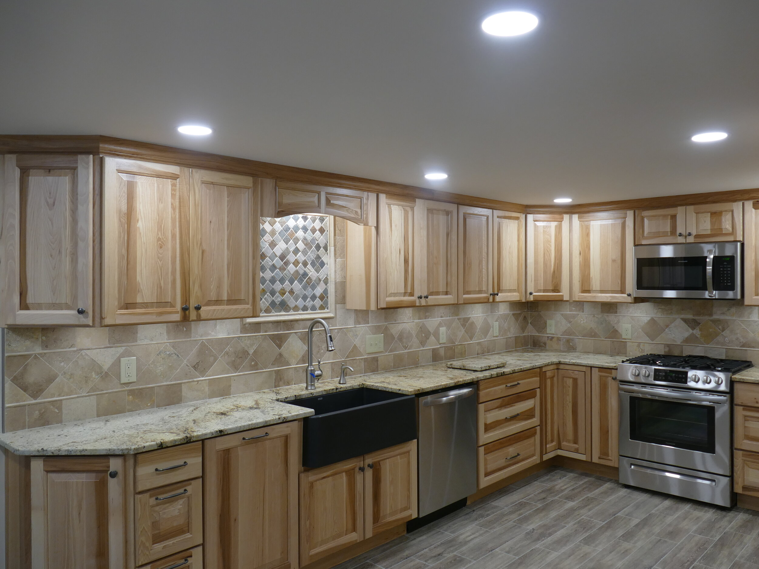 Full kitchen remodel with under cabinet lighting designed by Ink Design Concepts