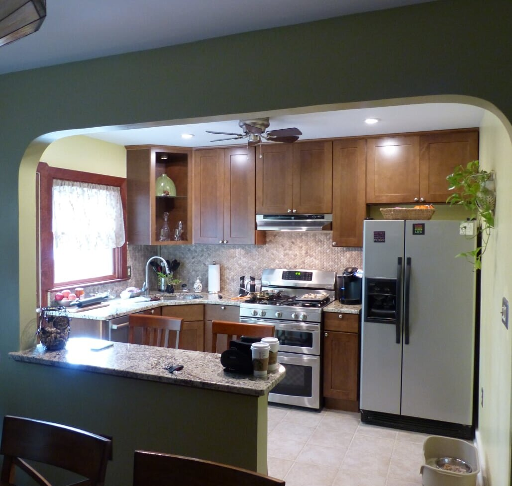 Removing a wall can open up a kitchen, but beware of hidden complications.