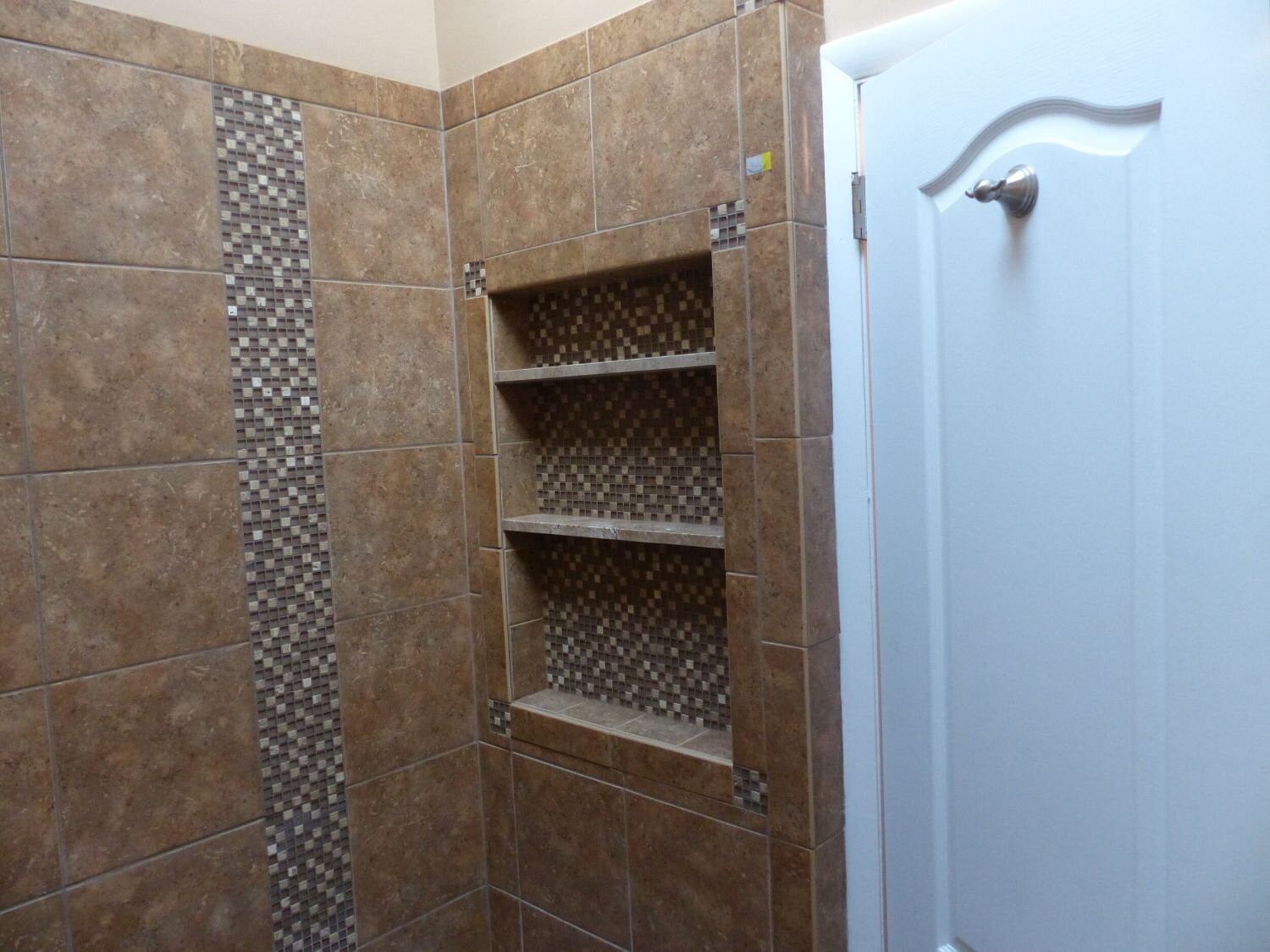 An inset shelf can add additional space for you to put your toiletries.