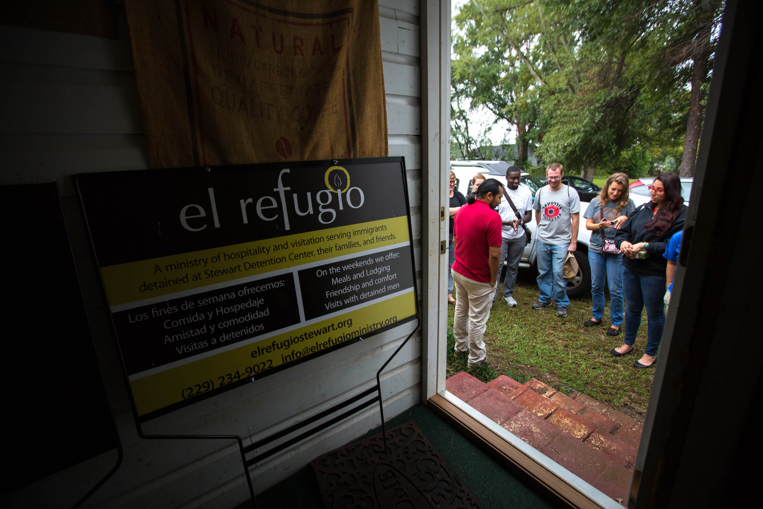 Amilcar Valencia gathers with a group of Emory University Students at El Refugio, Saturday, Sept. 12, 2015, in Lumpkin, Ga. (Photo by Branden Camp)