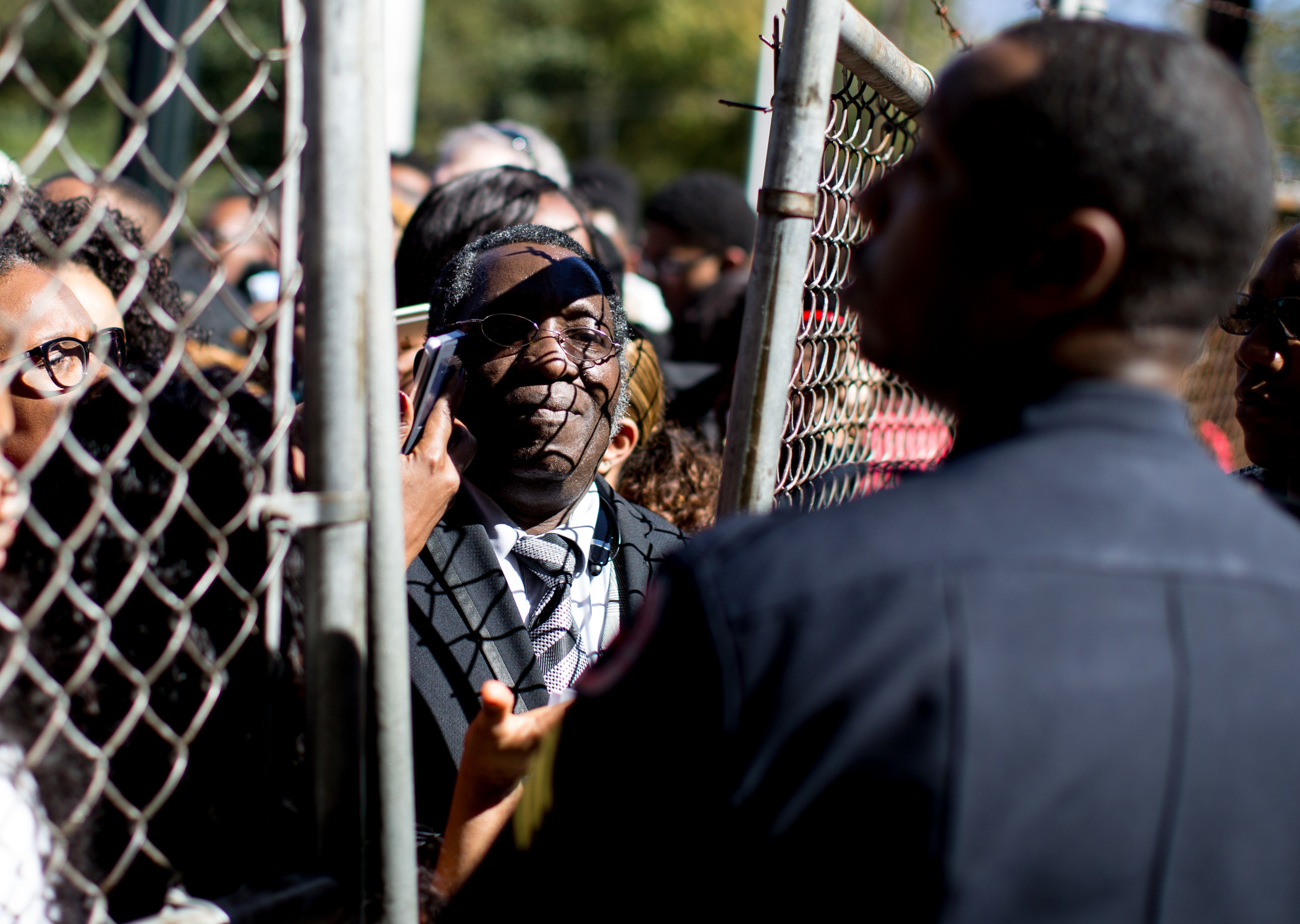 """A police officer holds people back as they line up to see Democratic presidential candidate Hillary Rodham Clinton speak at an """"African Americans for Hillary"""" grassroots event at Clark Atlanta University in Atlanta, Friday, Oct. 30, 2015.  (Photo by Branden Camp)"""