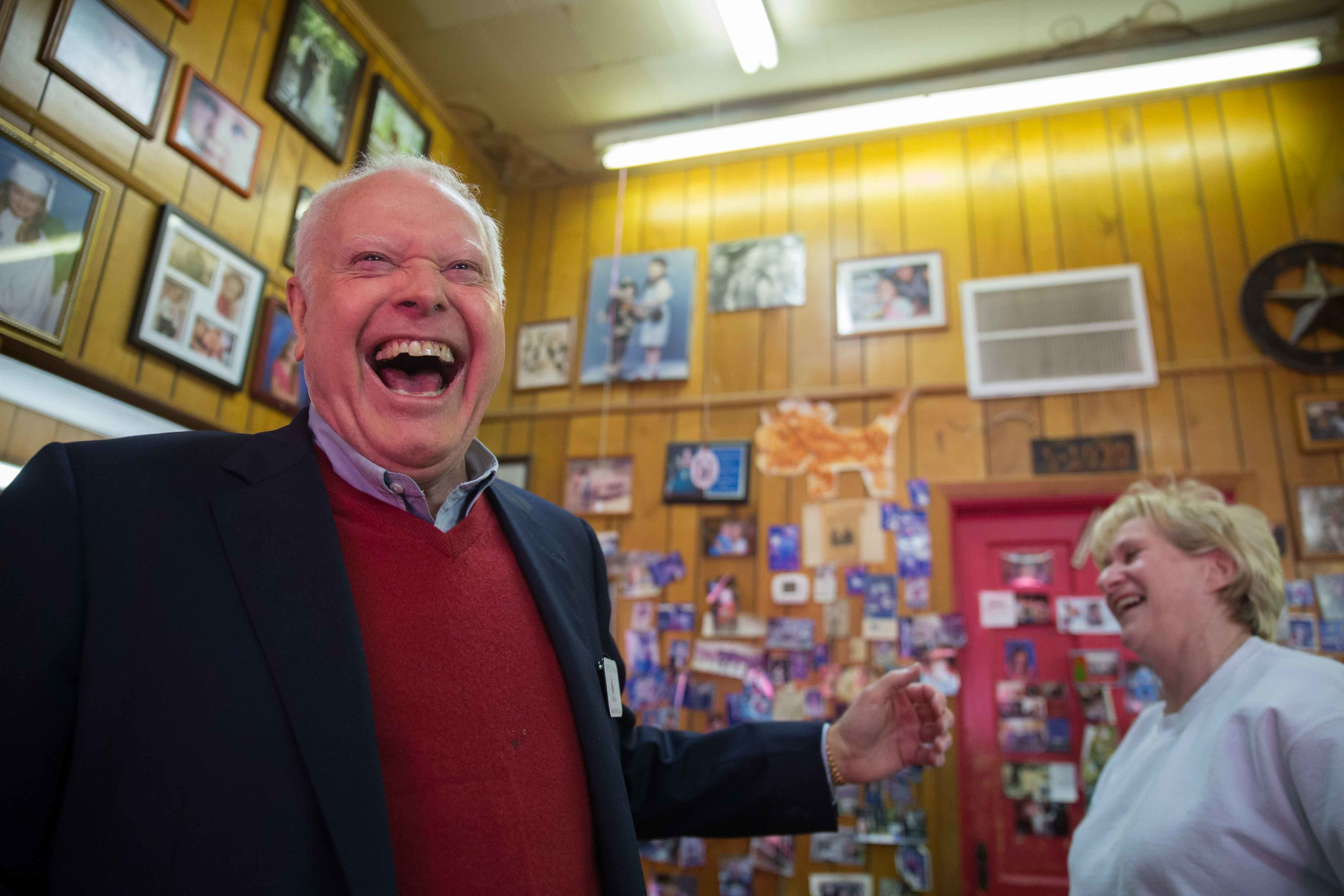 Joe McCutchen, supporter of Republican presidential candidate Ted Cruz, laughs with his barber Marcelle Lowry at City Barber Shop, Saturday, Dec. 5, 2015, in Ellijay, Ga. BRANDEN CAMP FOR THE BOSTON GLOBE