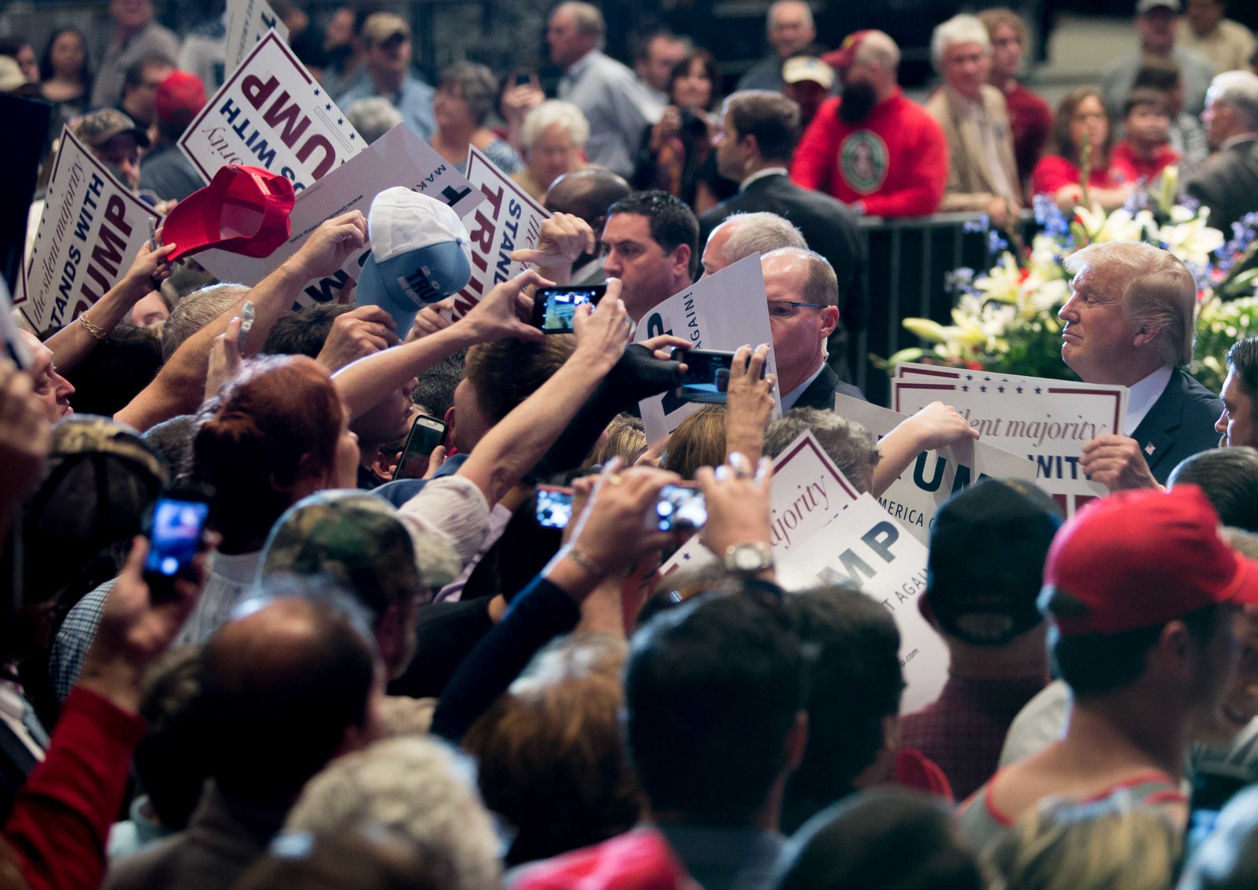 Republican presidential candidate Donald Trump signs autographs after speaking at a campaign rally, Monday, Nov. 30, 2015 at the Macon Centreplex in Macon, Ga. (AP Photo/Branden Camp)