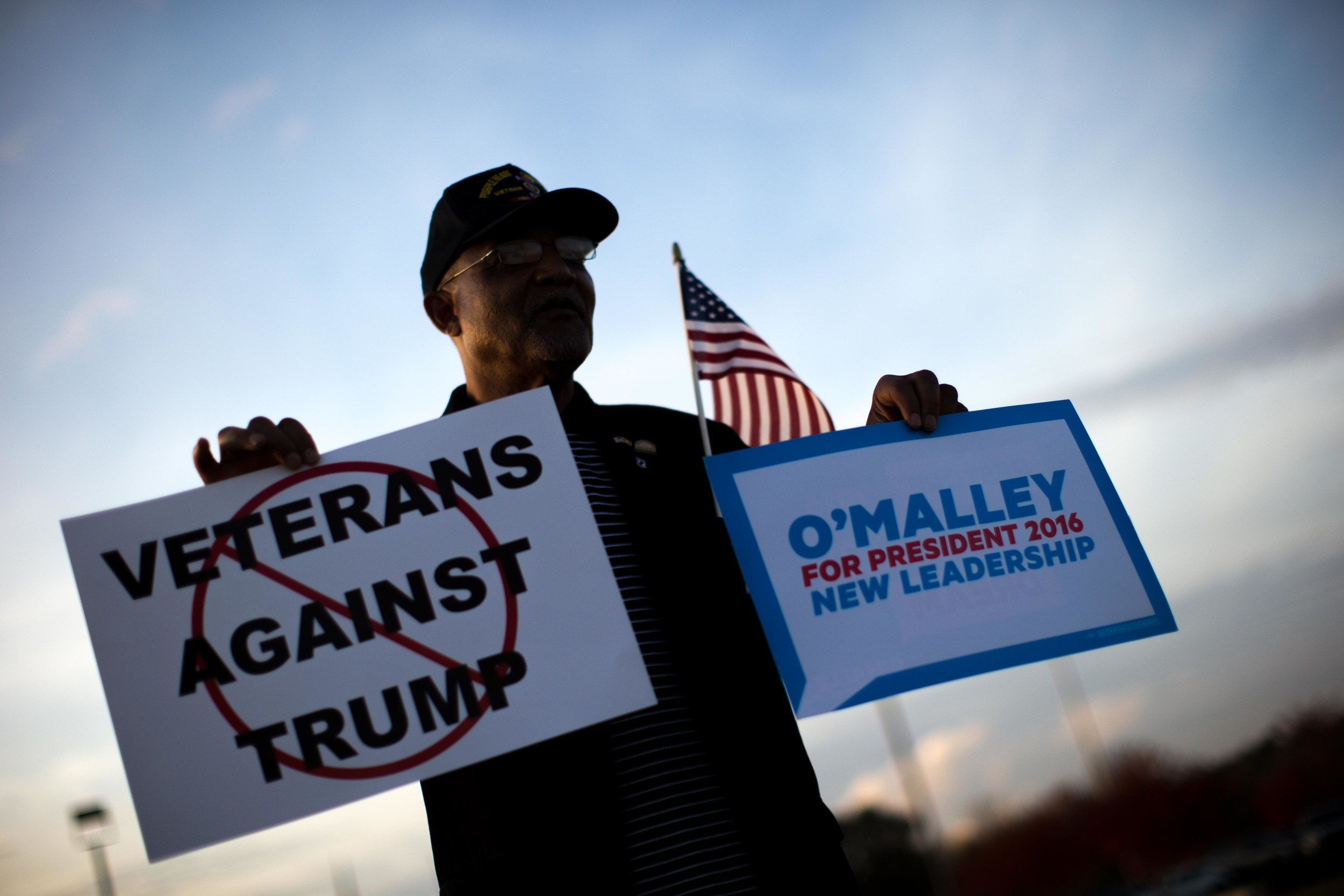 Former Macon Mayor C. Jack Ellis protests outside of the Macon Centreplex in Macon, Ga. where Republican presidential candidate Donald Trump is set to hold a campaign rally. (Ap Photo/Branden Camp)