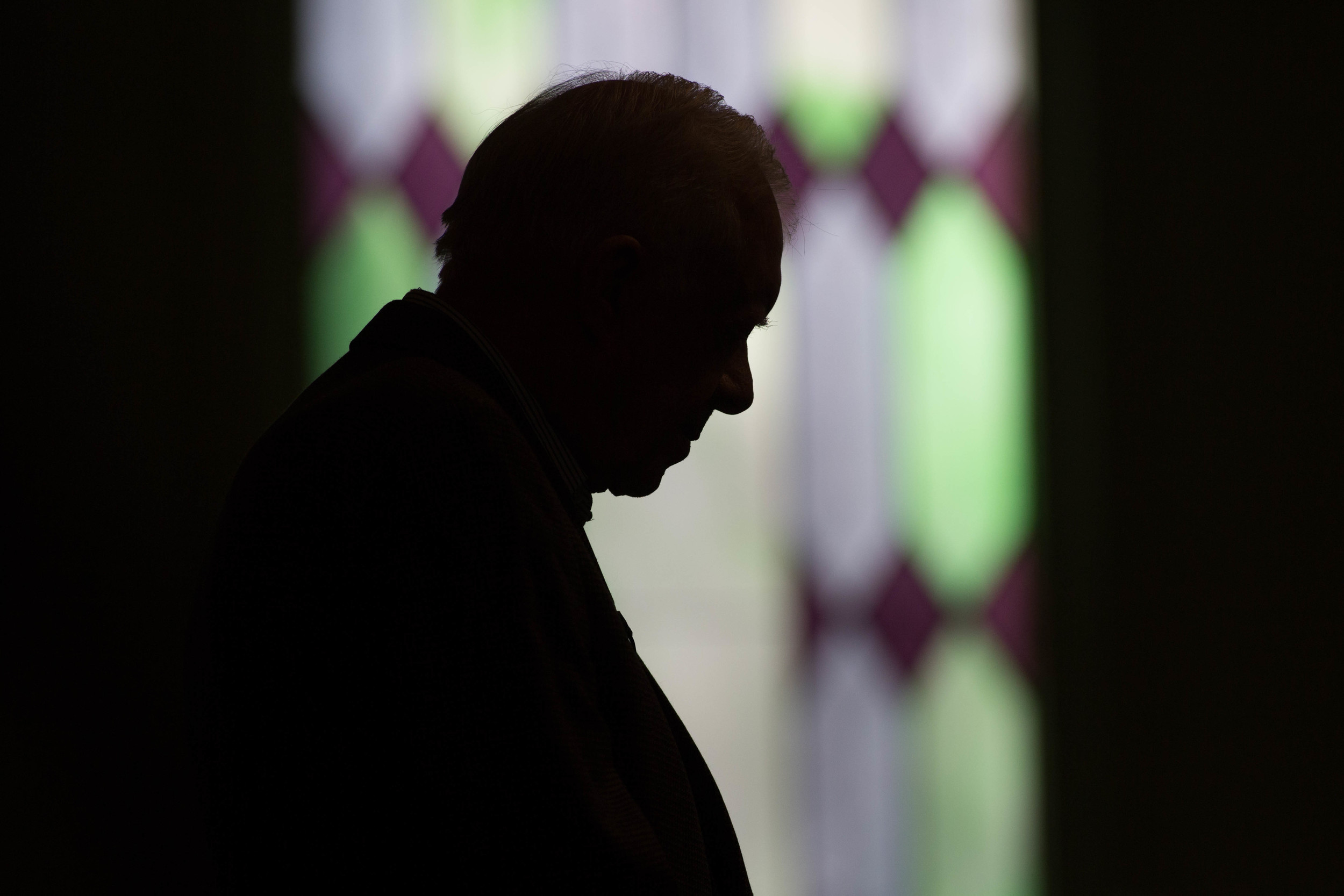 """Former President Jimmy Carter prays during Sunday School class at Maranatha Baptist Church in his hometown, Sunday, Dec. 13, 2015, in Plains, Ga. A recent MRI showing no cancer on Jimmy Carter's brain is """"very positive"""" news for the former president but will not end his medical treatment, doctors said. Carter, 91, announced on Dec. 6 that doctors found no evidence of the four lesions discovered on his brain this summer and no signs of new cancer growth. (AP Photo/Branden Camp)"""