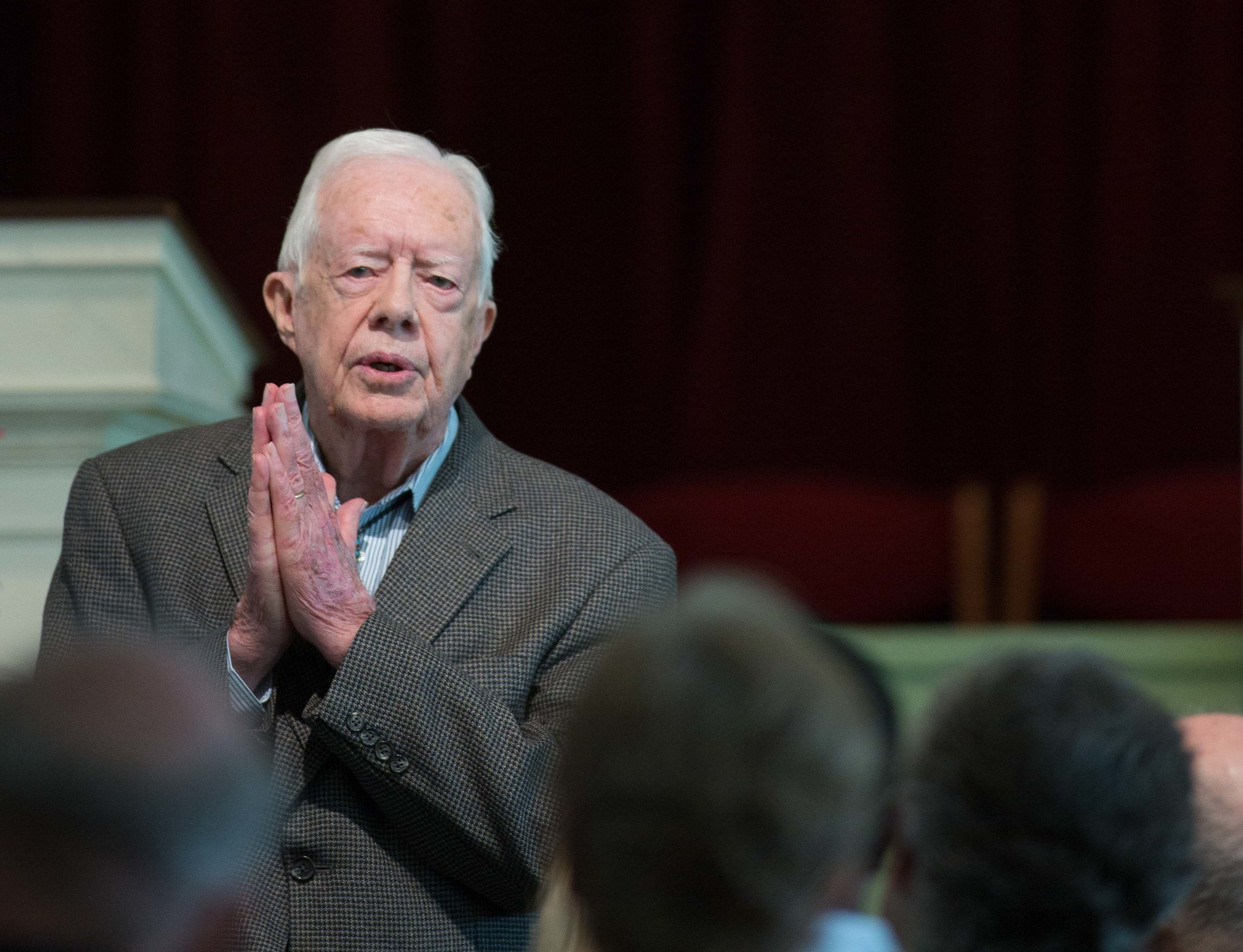 """Former President Jimmy Carter teaches during Sunday School class at Maranatha Baptist Church in his hometown, Sunday, Dec. 13, 2015, in Plains, Ga. A recent MRI showing no cancer on Jimmy Carter's brain is """"very positive"""" news for the former president but will not end his medical treatment, doctors said. Carter, 91, announced Dec. 6 that doctors found no evidence of the four lesions discovered on his brain this summer and no signs of new cancer growth. (AP Photo/Branden Camp)"""