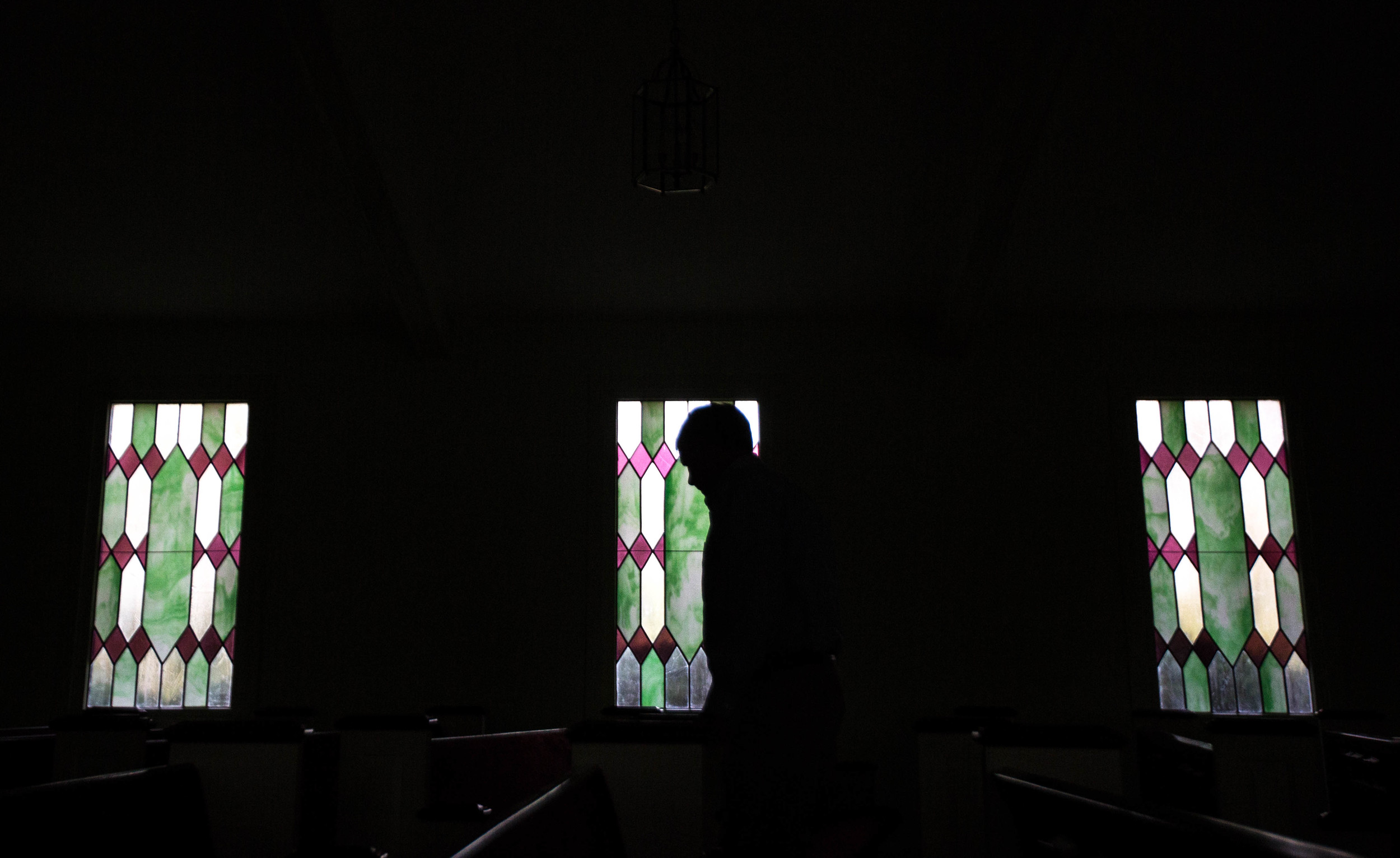 """A church member cleans up the sanctuary after former President Jimmy Carter taught Sunday School class at Maranatha Baptist Church in his hometown, Sunday, Dec. 13, 2015, in Plains, Ga. A recent MRI showing no cancer on Jimmy Carter's brain is """"very positive"""" news for the former president but will not end his medical treatment, doctors said. Carter, 91, announced on Dec. 6 that doctors found no evidence of the four lesions discovered on his brain this summer and no signs of new cancer growth. (AP Photo/Branden Camp)"""