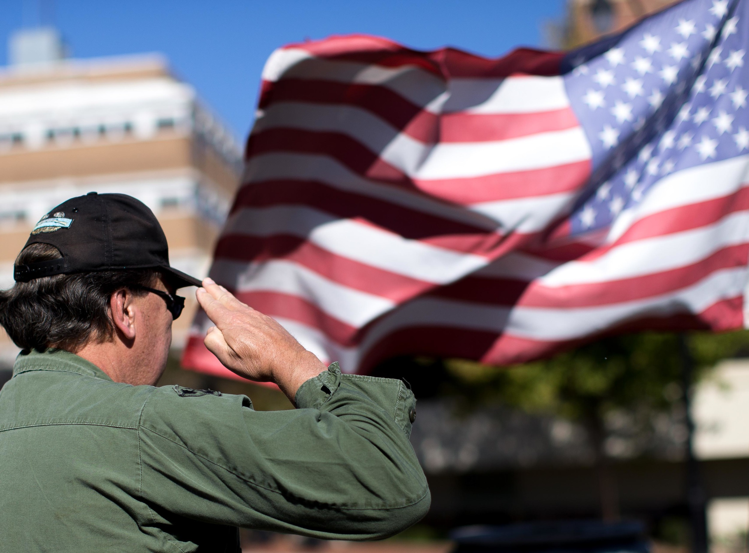 Nov. 11, 2015 - Marietta, Ga, U.S - DAVID THOMAS, a Vietnam War Army veteran, salutes during a parade on Veterans Day. Thomas deployed to Vietnam from 1970-71. (Credit Image: © Branden Camp via ZUMA Wire)