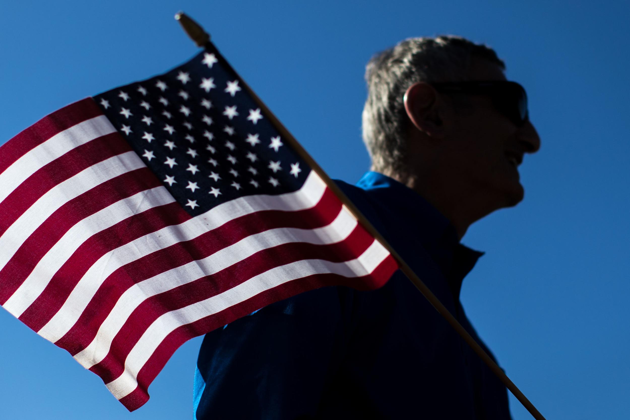 Nov. 11, 2015 - Marietta, Ga, U.S - GEORGE ESSAFF holds a flag during a Veterans Day parade. (Credit Image: © Branden Camp via ZUMA Wire)