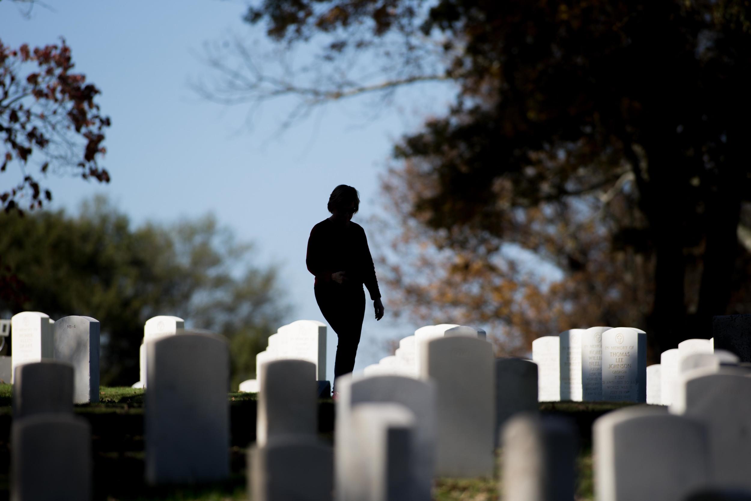 Nov. 11, 2015 - Marietta, Ga, U.S - A woman walks through Marietta National Cemetery on Veterans Day. (Credit Image: © Branden Camp via ZUMA Wire)