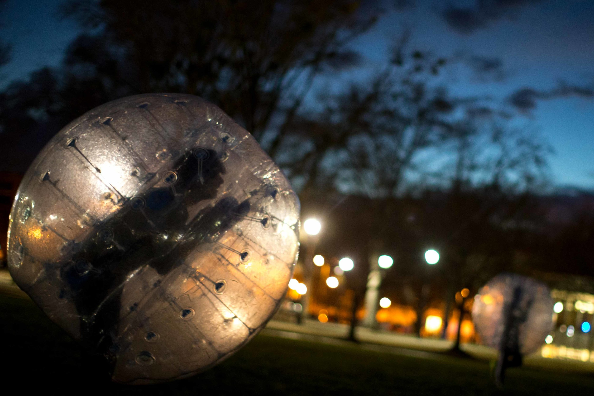 Kennesaw State University students play a game of bubble soccer on campus at sunset, Thursday, Jan. 28, 2016, in Kennesaw, Ga. (AP Photo/Branden Camp)
