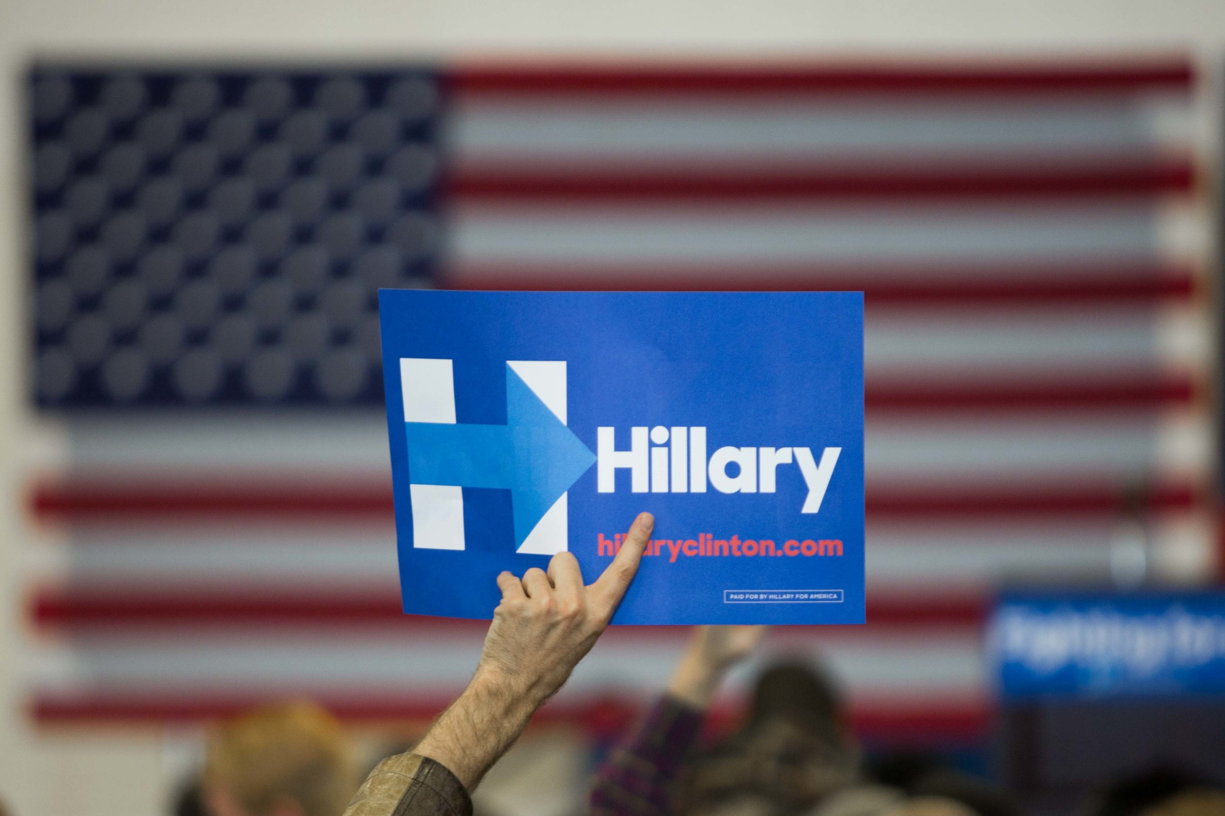 A man holds up a sign before former President Bill Clinton campaigns for his wife, Democratic presidential candidate Hillary Clinton, at North Clayton High School.  Branden Camp/ZUMA Wire