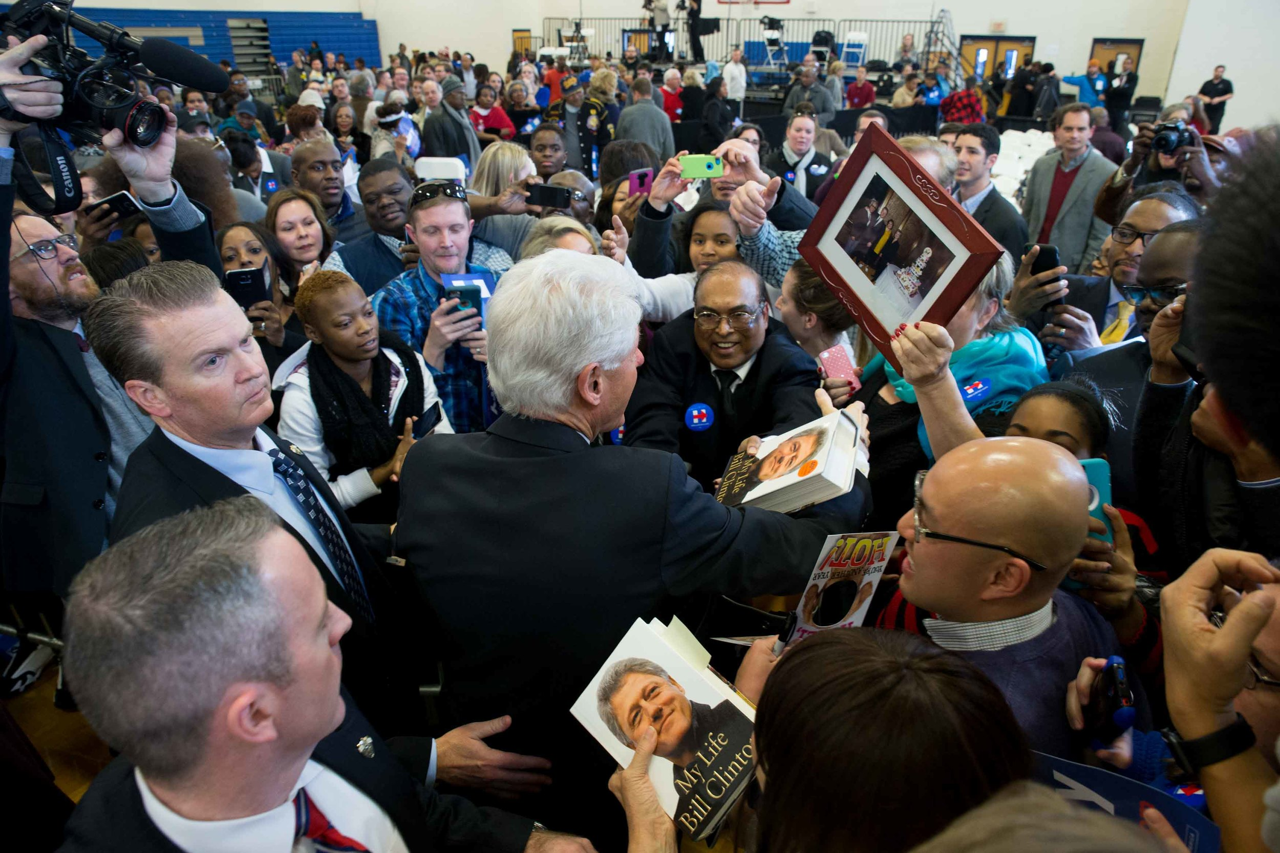 Former President Bill Clinton greets attendees during a campaign stop for his wife, Democratic presidential candidate Hillary Clinton, at North Clayton High School. Branden Camp/ZUMA wire