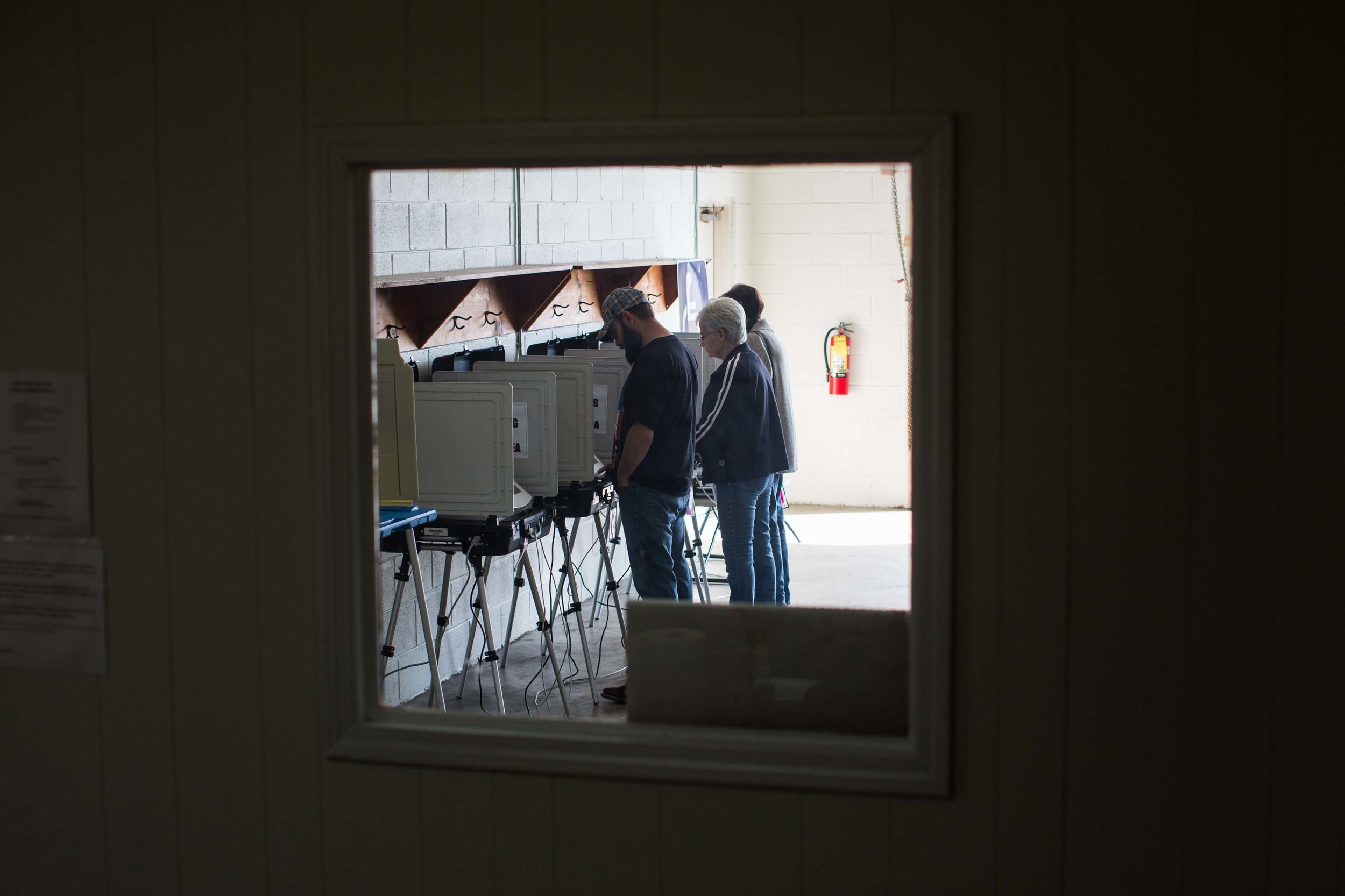 TAYLORSVILLE, GA - MARCH 1, 2016:  Georgia voters cast their ballots at Taylorsville Town Hall on Super Tuesday March 1, 2016, in Taylorsville, Georgia.  Voters head to the polls to cast their votes on Georgia's presidential primary.   (Photo by Branden Camp/Getty Images)