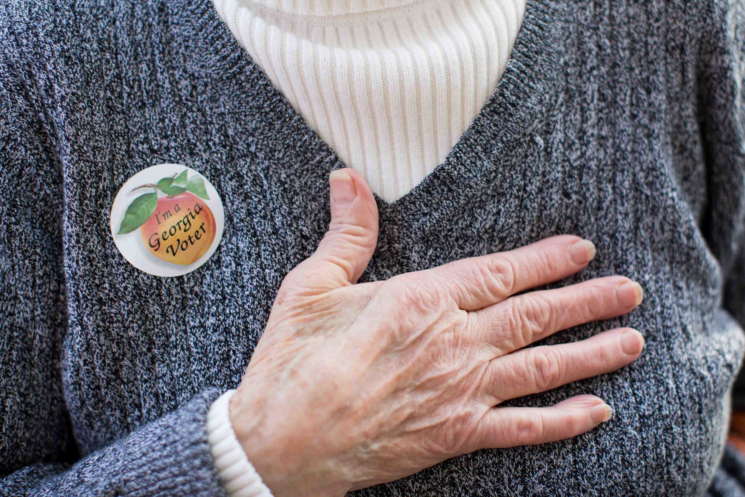 "TAYLORSVILLE, GA - MARCH 1, 2016:  Edna Martinez wears a ""I'm a Georgia Voter"" sticker after casting her ballot at Taylorsville Town Hall on Super Tuesday March 1, 2016, in Taylorsville, Georgia.  Voters head to the polls to cast their votes on Georgia's presidential primary. (Photo by Branden Camp/Getty Images)"