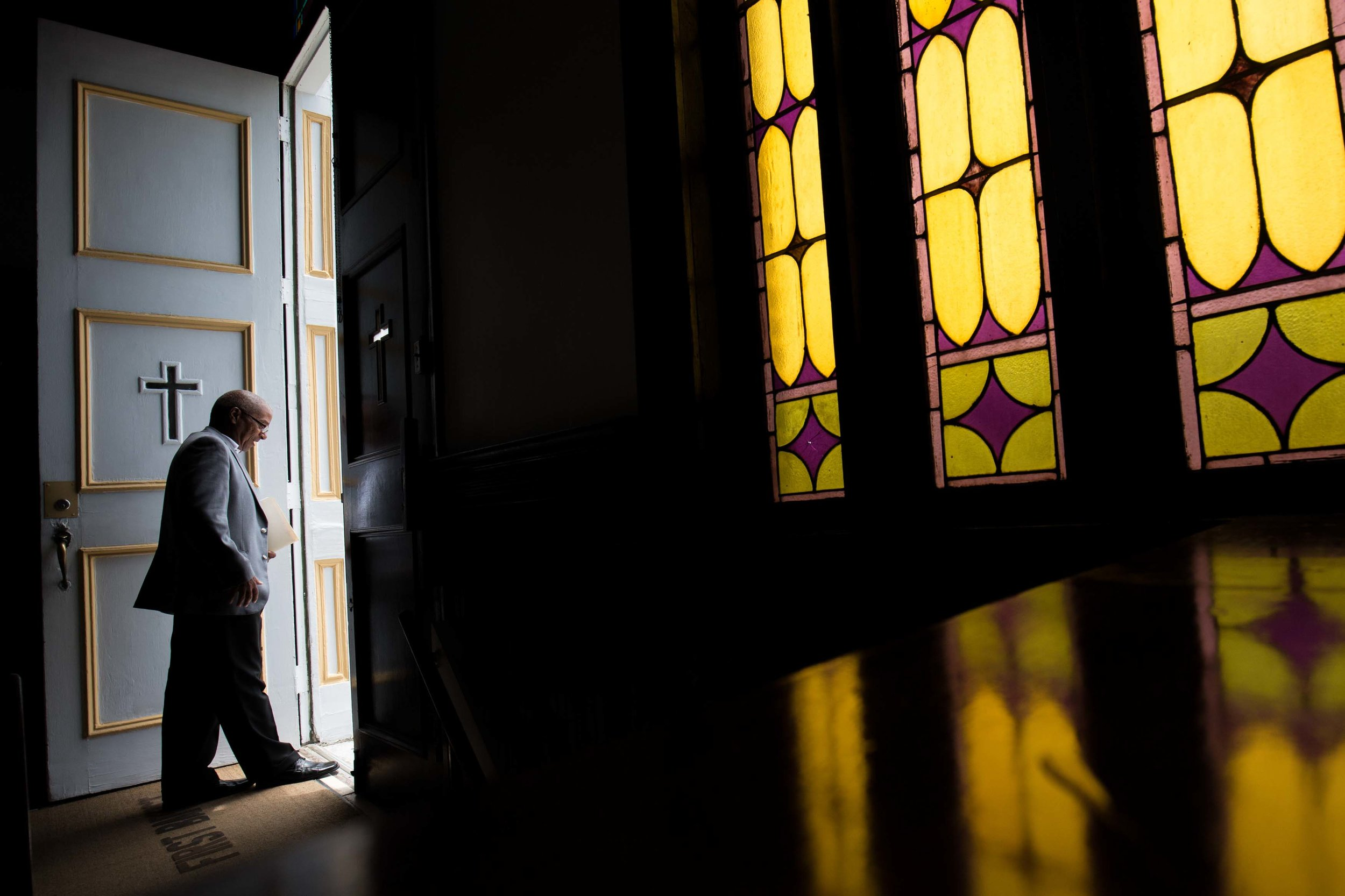 A parishioner at First Baptist Church, a predominantly African-American congregation, leaves after a worship service in Macon, Ga., on Sunday, July 10, 2016. There are two First Baptist Churches in Macon,one black and one white. (AP Photo/Branden Camp)