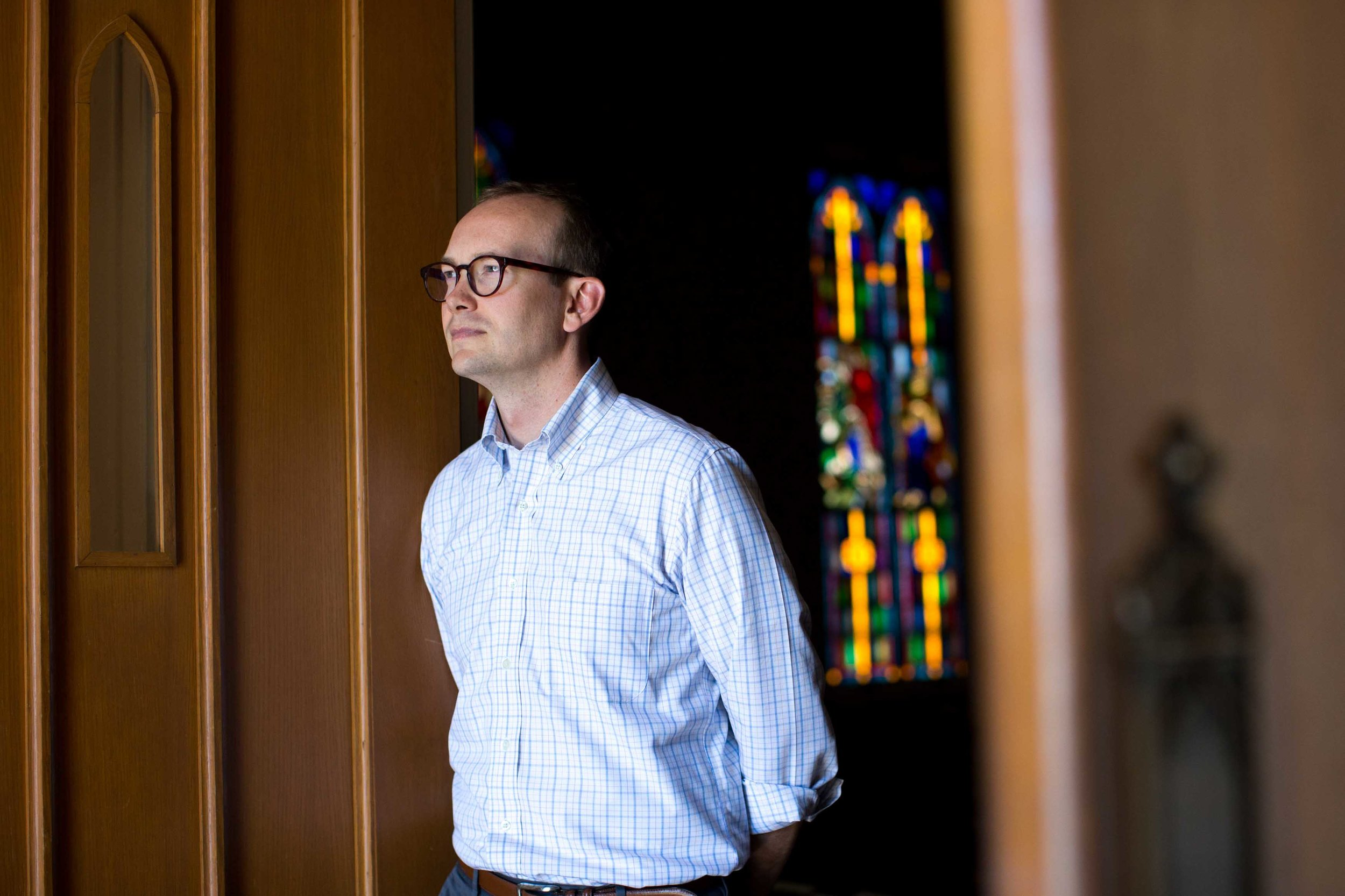 In this Monday, July 11, 2016 photo, the Rev. Scott Dickison poses for a portrait at the First Baptist Church of Christ, a predominantly white congregation, in Macon, Ga. The 33-year-old North Carolina native and Harvard Divinity School graduate became the pastor about four years ago. (AP Photo/Branden Camp)