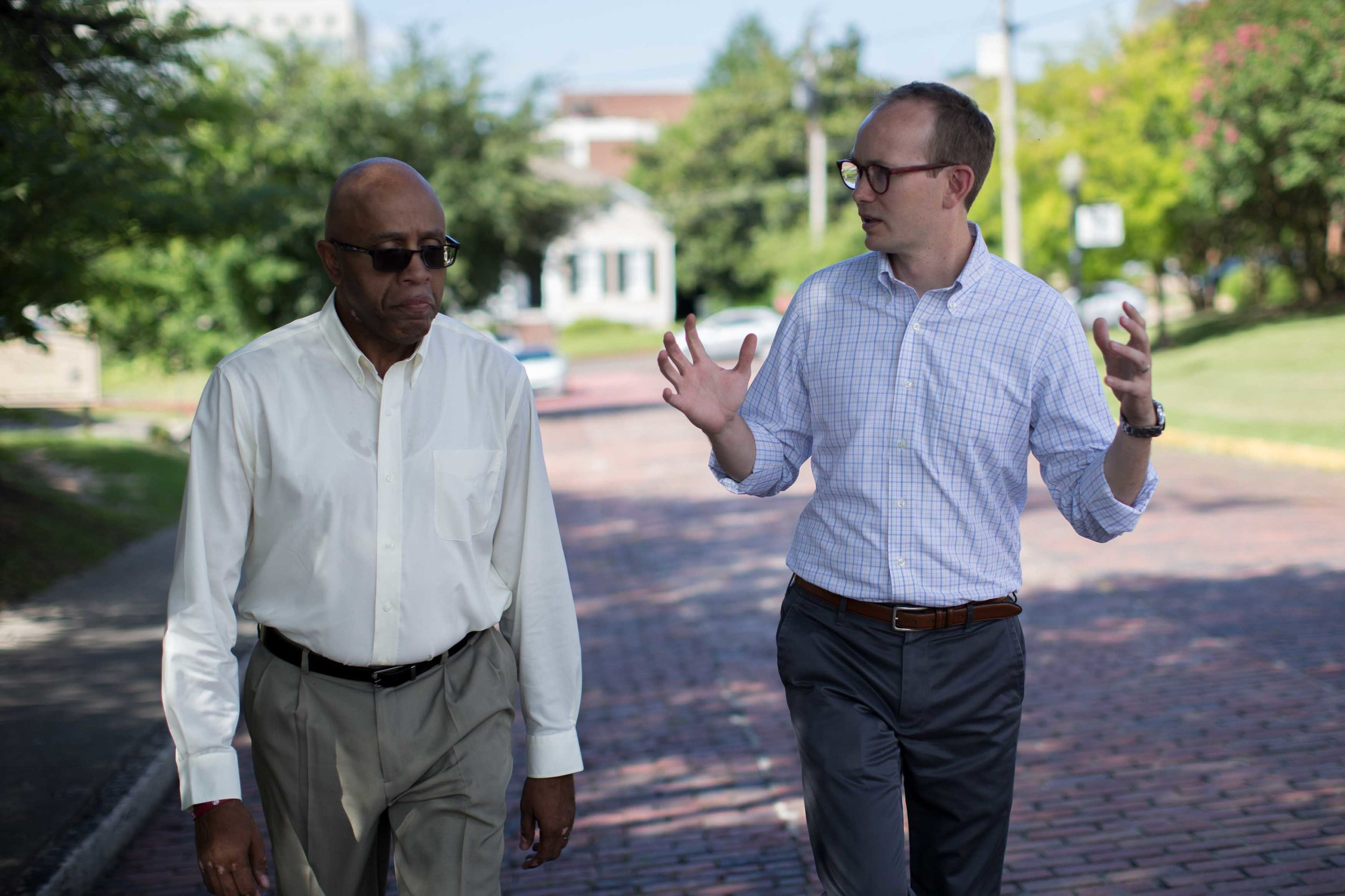 The Rev. James W. Goolsby, Jr., pastor of the First Baptist Church, left, and the Rev. Scott Dickison, pastor of the First Baptist Church of Christ, walk together in Macon, Ga., on Monday, July 11, 2016. In September 2016, they plan to lead joint discussions with their churches' members on racism in the history of the U.S., and also in the history of their congregations. (AP Photo/Branden Camp)
