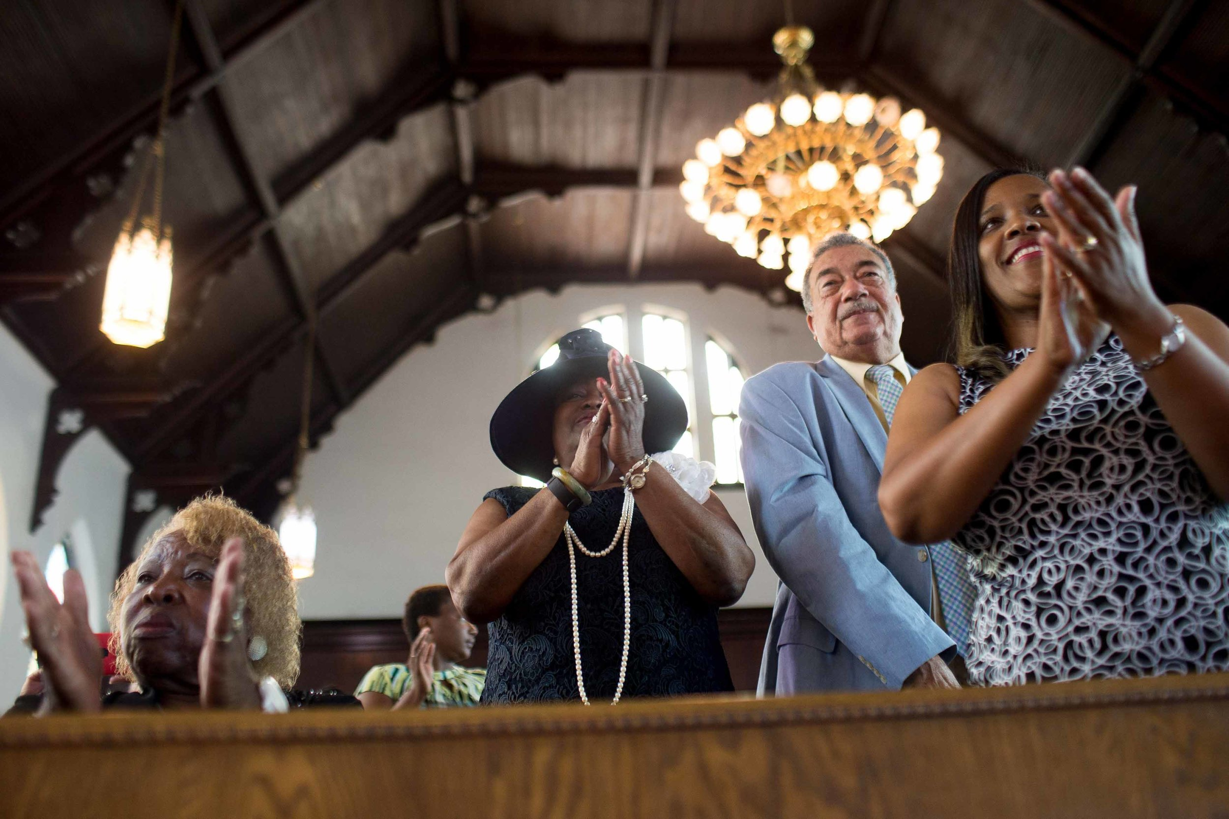 Parishioners clap during a worship service at the First Baptist Church, a predominantly African-American congregation, in Macon, Ga., on Sunday, July 10, 2016. There are two First Baptist Churches in Macon _ one black and one white. (AP Photo/Branden Camp)