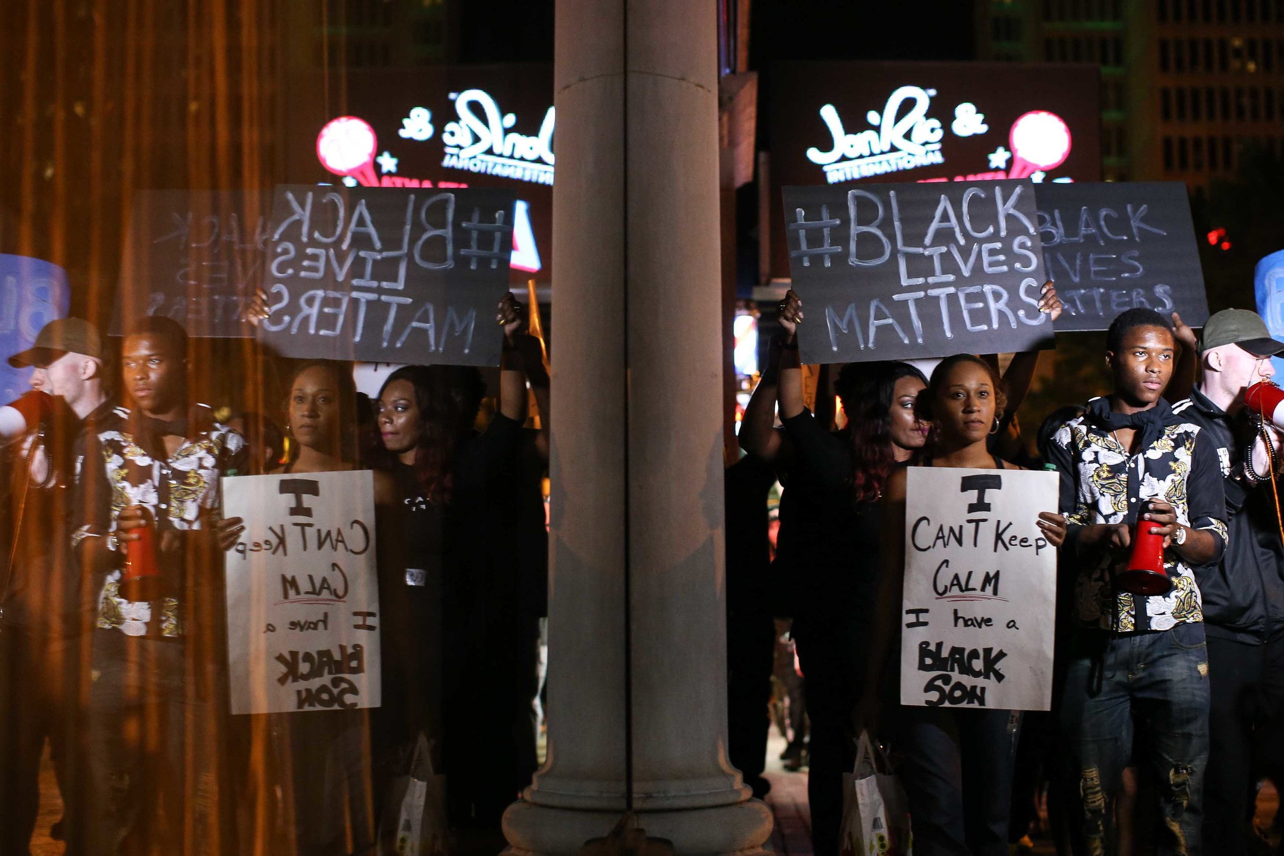 Black Lives Matter protesters march in downtown Atlanta, Saturday, Sept. 24, 2016, in response to the police shooting deaths of Terence Crutcher in Tulsa, Okla. and Keith Lamont Scott in Charlotte, N.C.  (AP Photo/Branden Camp)