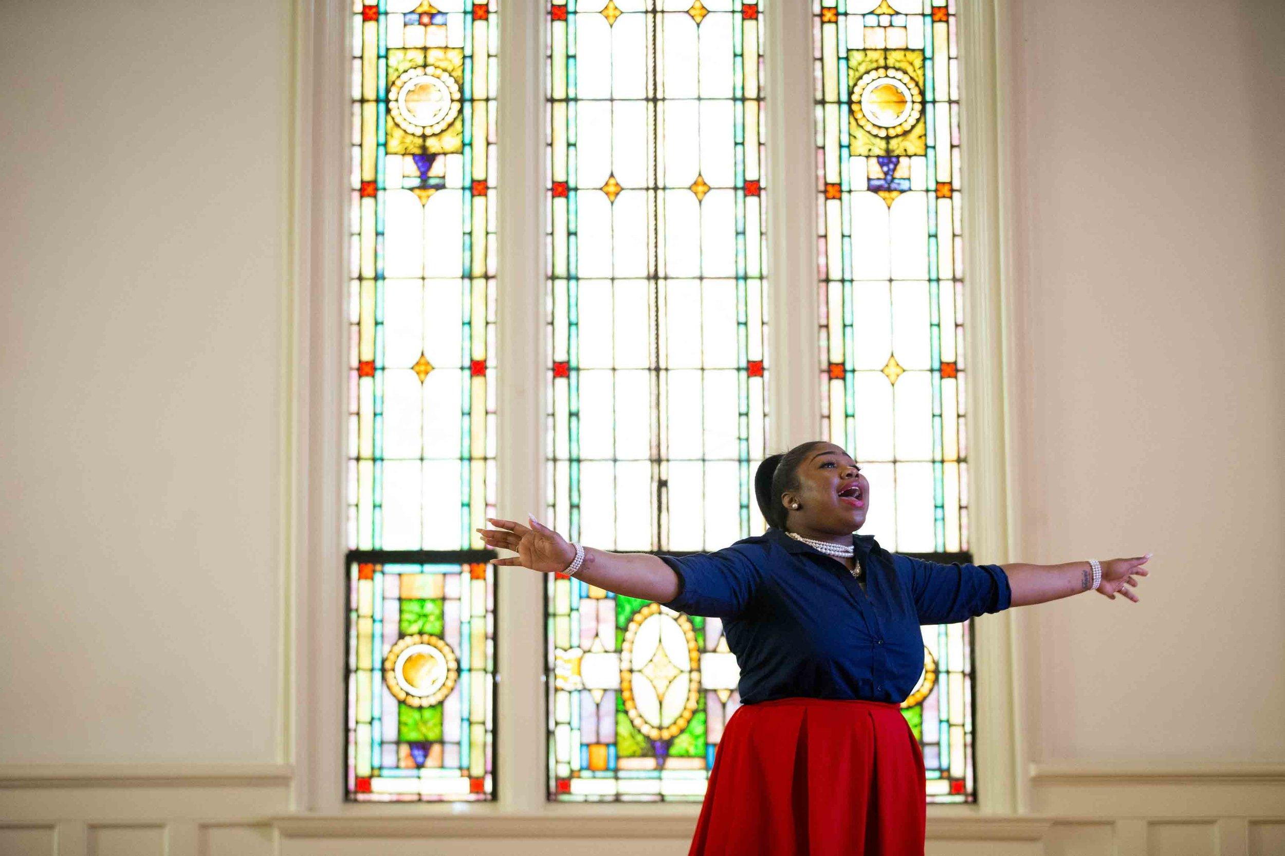 Octavia Jones reacts as pastor Billy Honor preaches during a church service at Pulse Church, Sunday, Nov. 13, 2016, in Atlanta.    Branden Camp / for NBC News