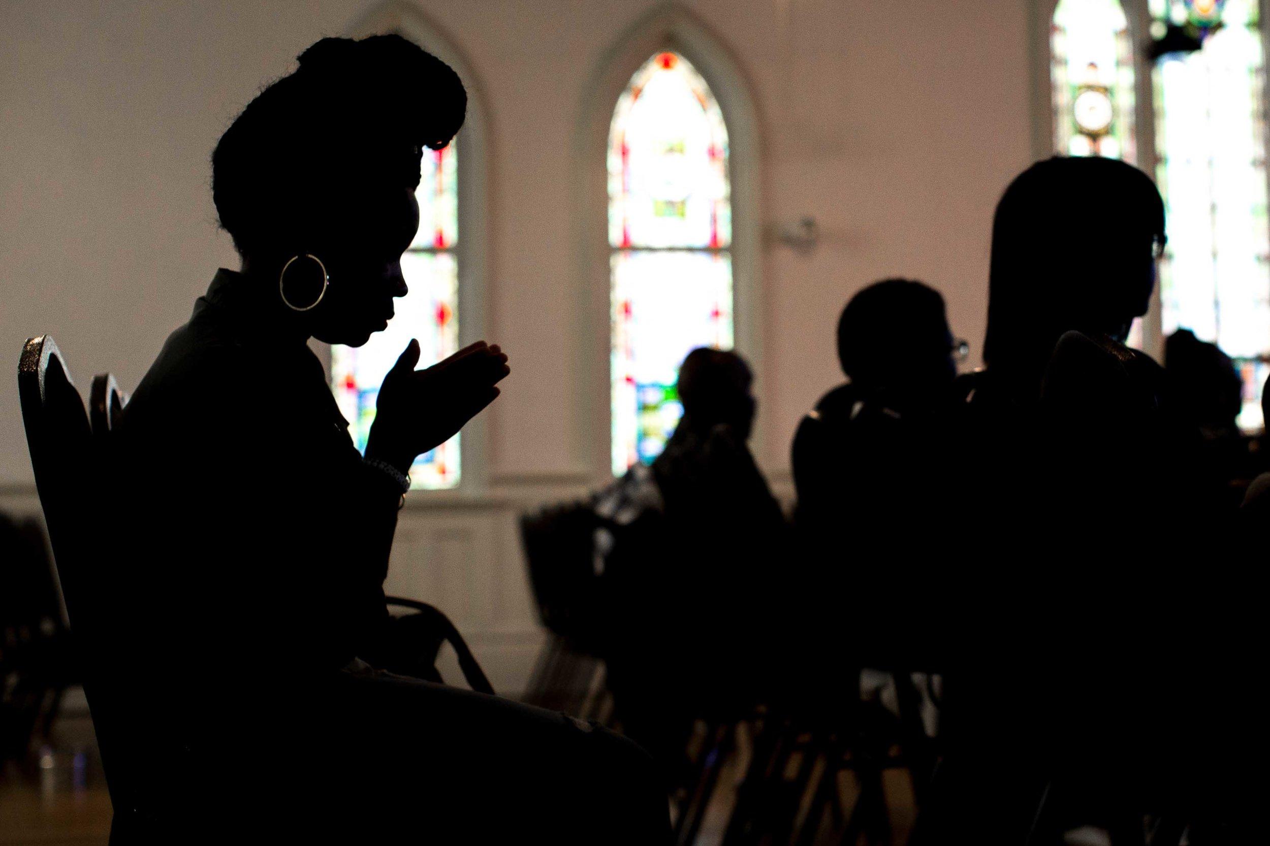 A woman prays during a church service at Pulse Church, Sunday, Nov. 13, 2016, in Atlanta.    Branden Camp / for NBC News