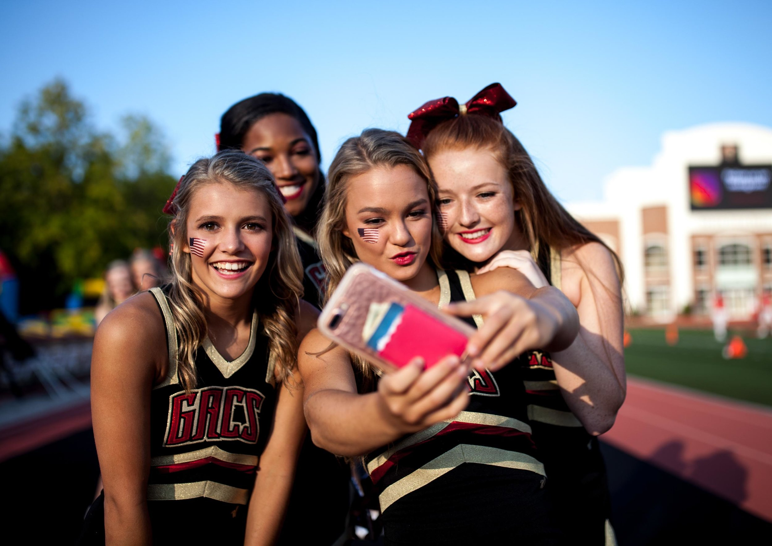 Greater Atlanta Christian cheerleaders pose for a photo before a high school football game against Valor Christian of Colorado, Friday, Sept. 8, 2017, in Norcross, Ga.Branden Camp for The AJC