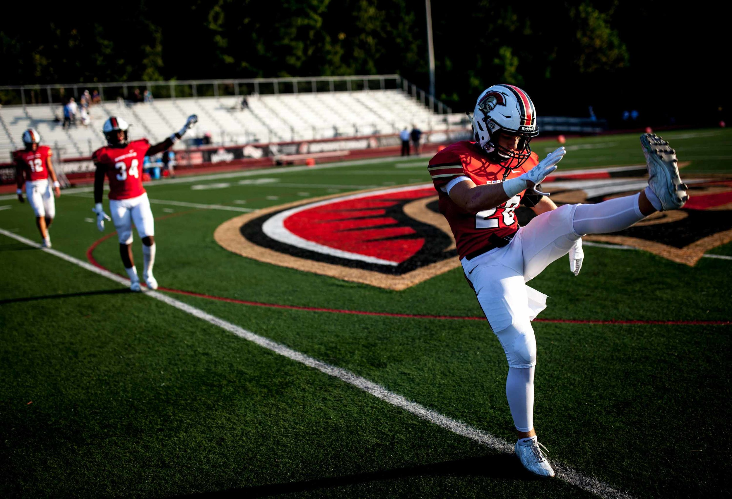 Greater Atlanta Christian football players warm up before a high school football game against Valor Christian of Colorado, Friday, Sept. 8, 2017, in Norcross, Ga.Branden Camp for The AJC