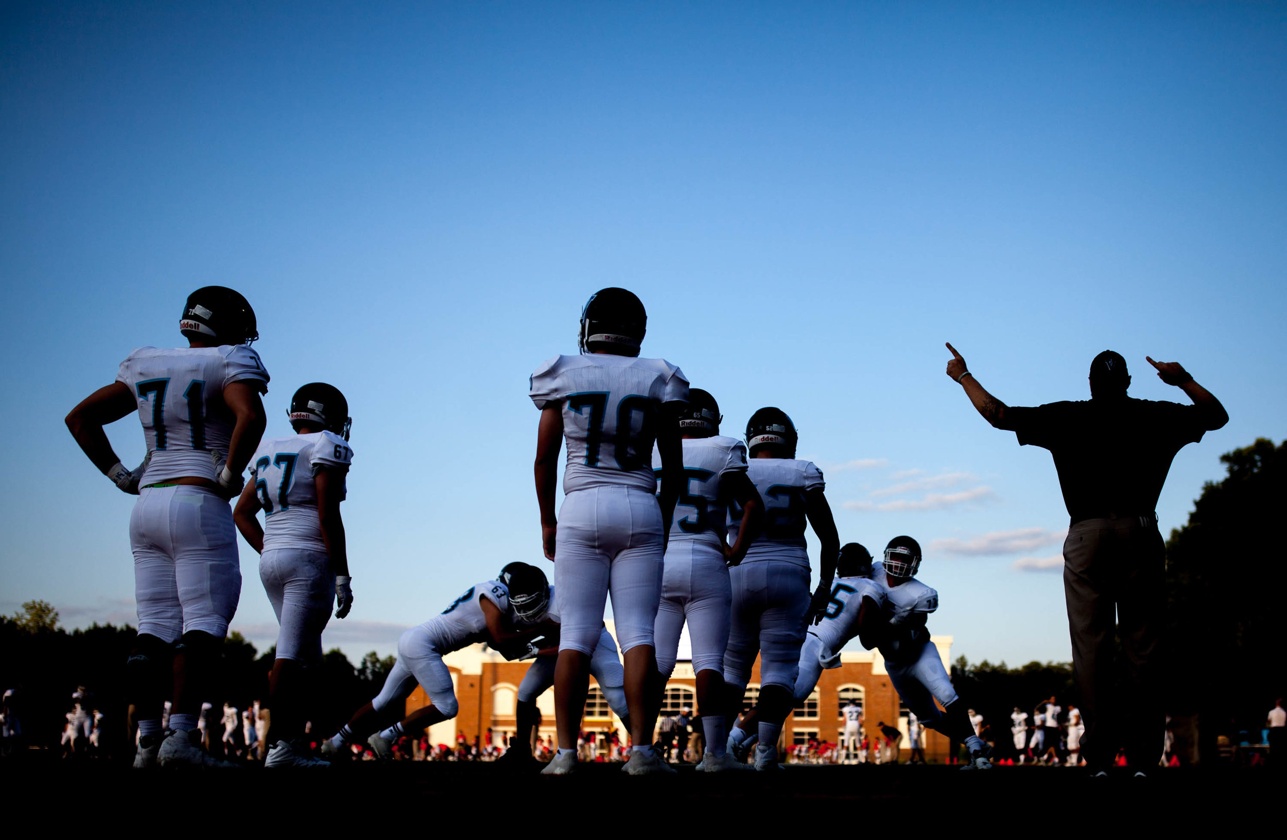 Valor Christian football players of Colorado warm up before a high school football game against Greater Atlanta Christian School, Friday, Sept. 8, 2017, in Norcross, Ga. Branden Camp for The AJC